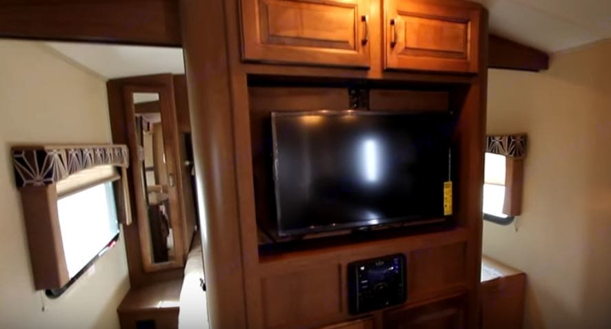 The entertainment center features a TV that swivels to face the living room/kitchen area or you can swivel it so it's in the bedroom!. Cruiser Rv Corp Fun Finder 2015