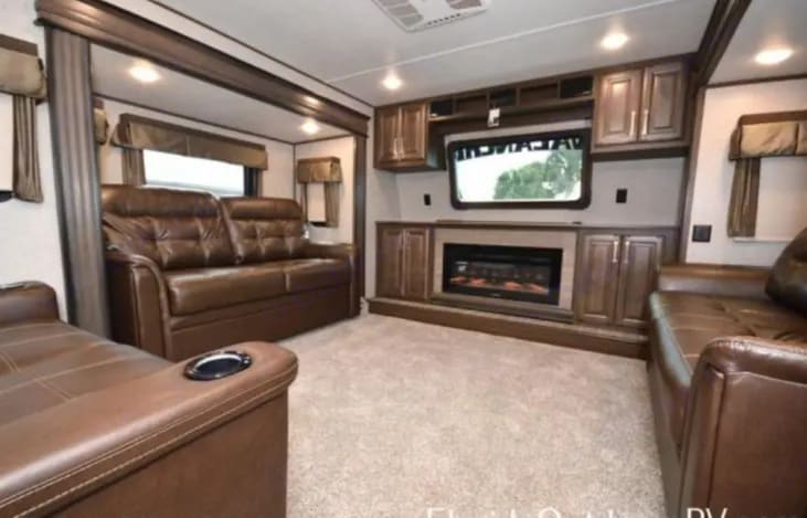 Living room view with two pull out queen beds. Keystone Avalanche 2019