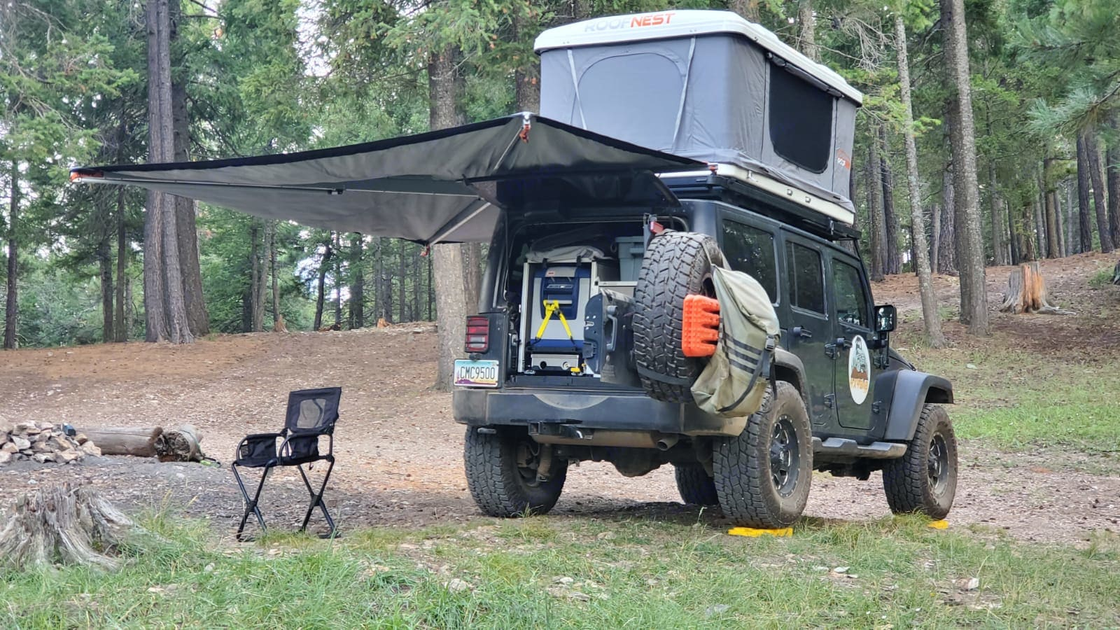 """Equipped with a roof top tent, awning, fridge, stove, cutting board, and cabinets- everything needed for a """"Bed and Breakfast""""!. Jeep Wrangler Unlimited 2016"""