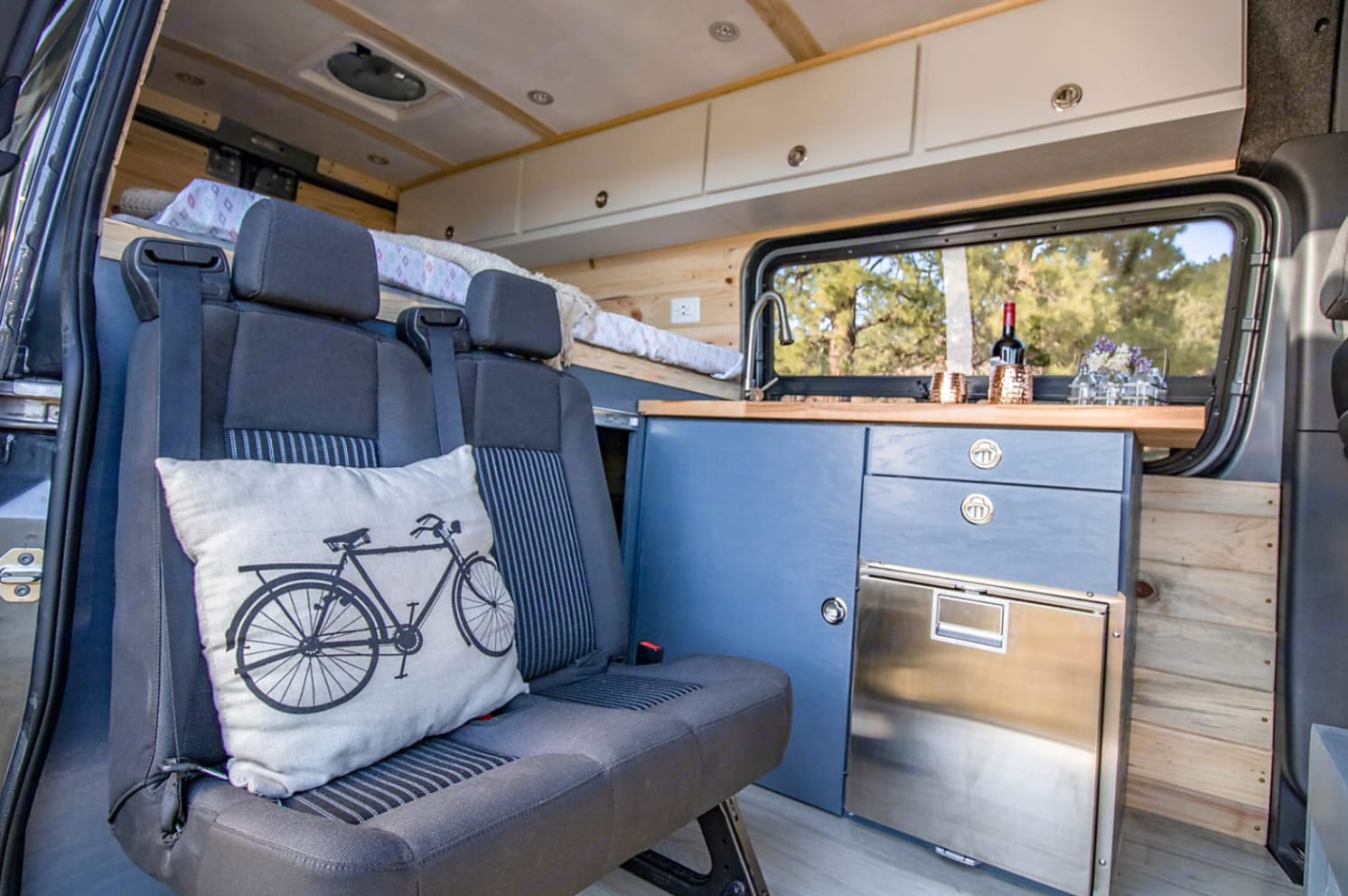 Kitchen has running water with 9 gallon fresh and grey water tanks, and a stainless steel refrigerator.. Mercedes-Benz Sprinter 2019