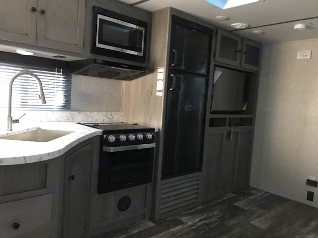 Entertainment center with stereo and DVD player. Kitchen with 3 burner stove, oven and microwave.. Keystone Outback 2020