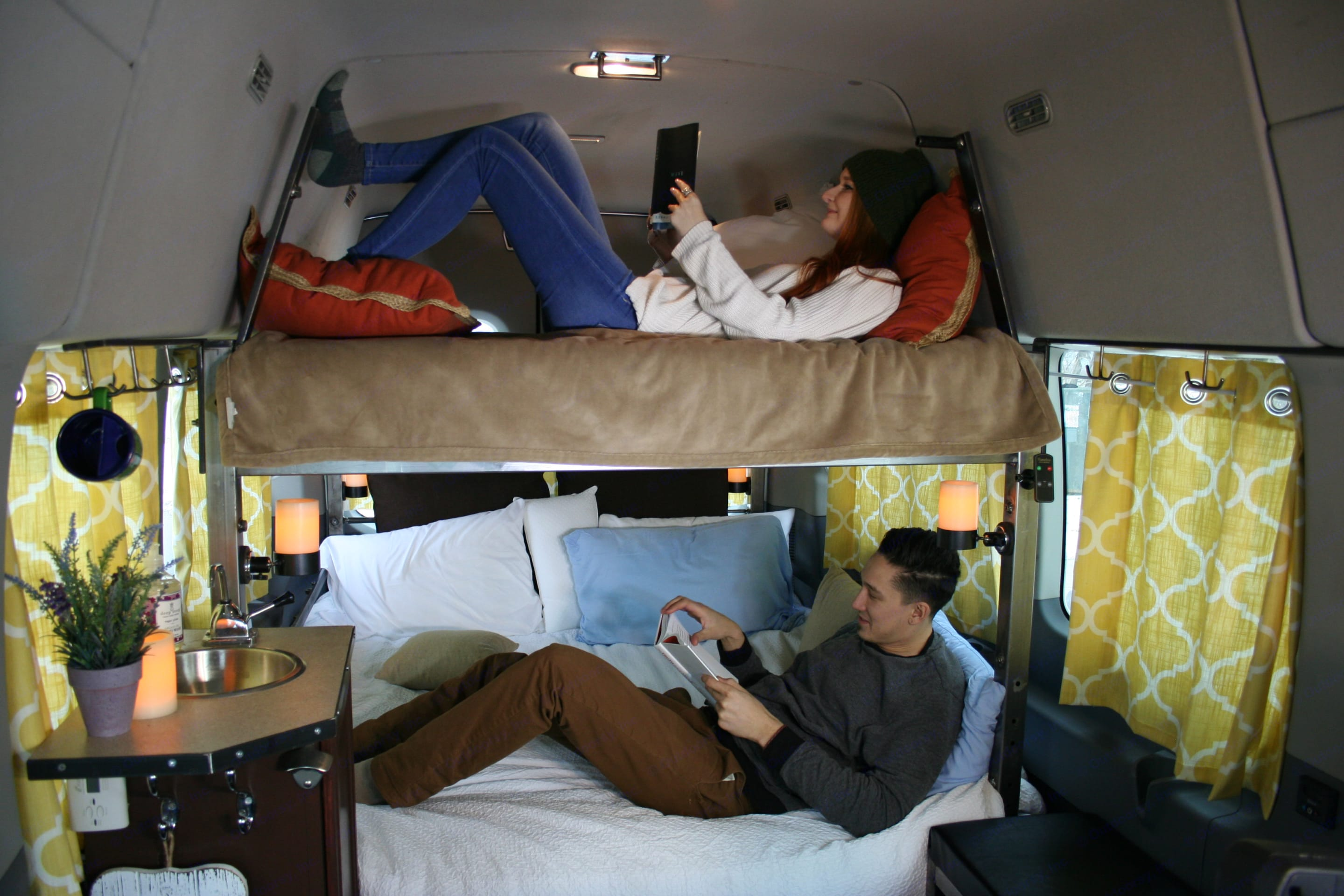 Two queen memory foam mattresses for room for all! Optional hammock for the second row that can fit a small child. . Ford Transit 2019