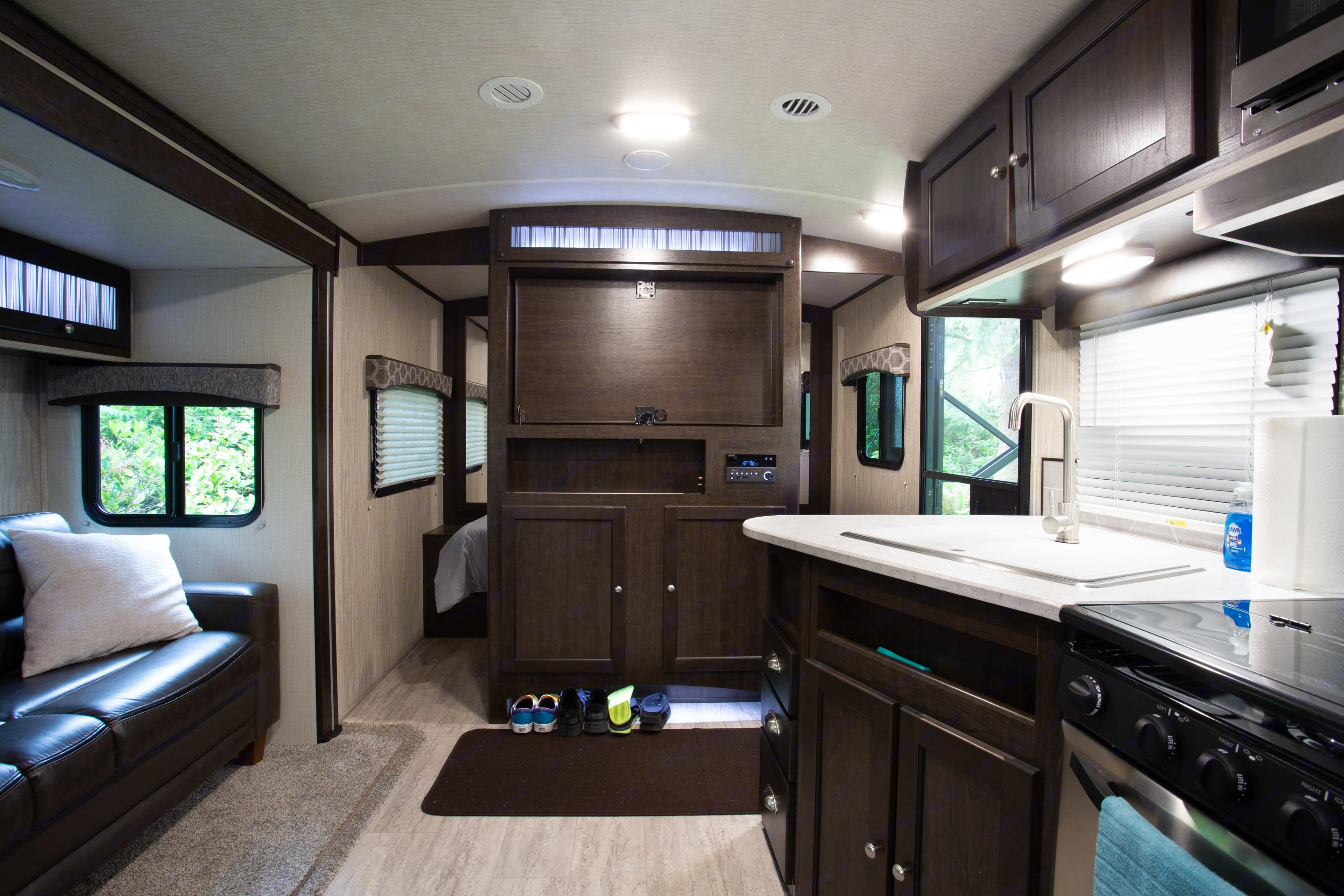 The TV Console in the center swivels around for viewing from the Master Bedroom side. TV added after photos.. CruiserRvCorp ShadowCruiser 2020