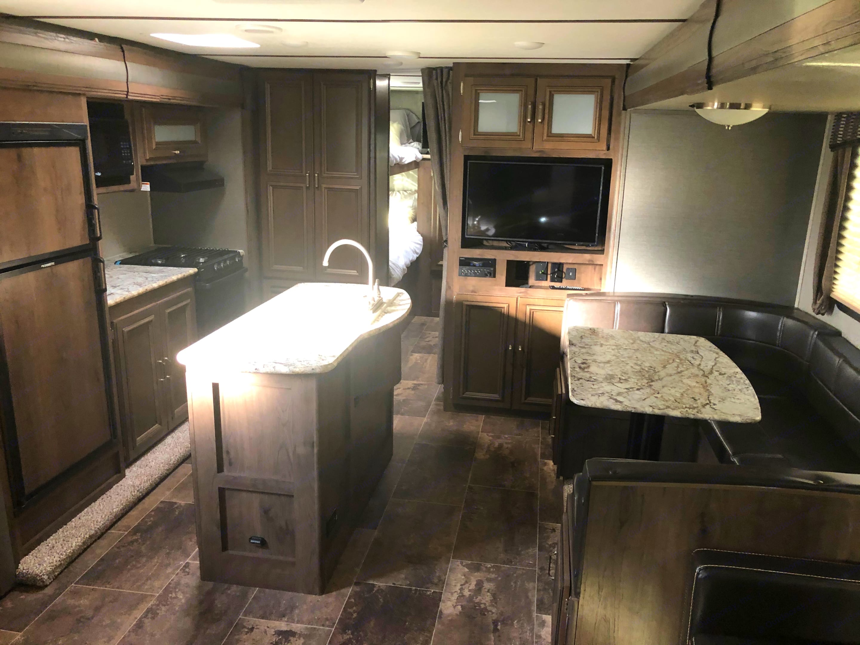 Main area with spacious dinette. Keystone Premier Ultra Lite 2019