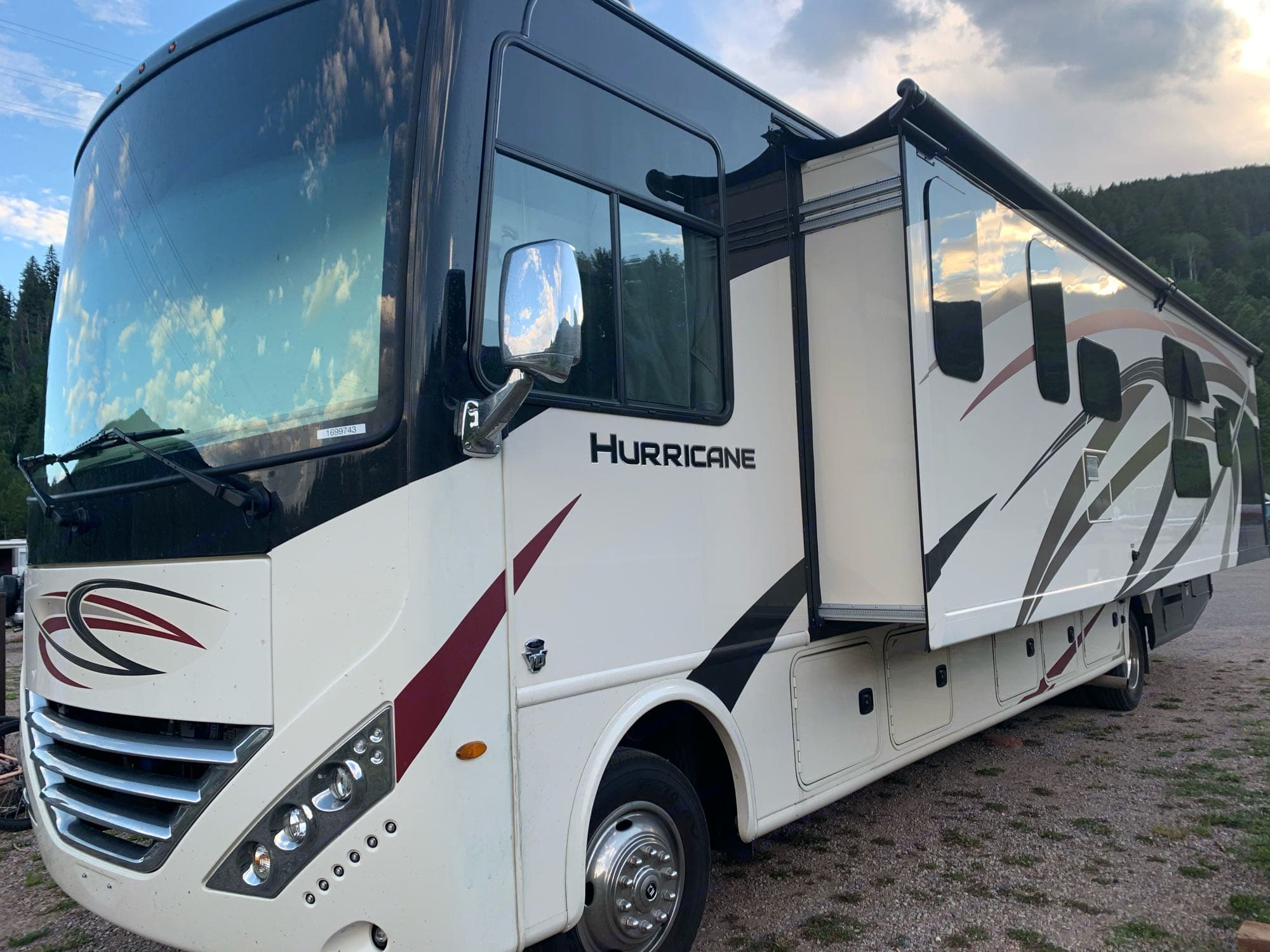 Exterior with extended slide out. Thor Motor Coach Hurricane 2020