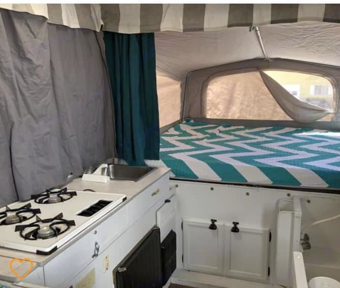 Moby's king sized bed & privacy curtains. (Queen sized bed on the other side - more pictures to come). Jayco 1007 1996