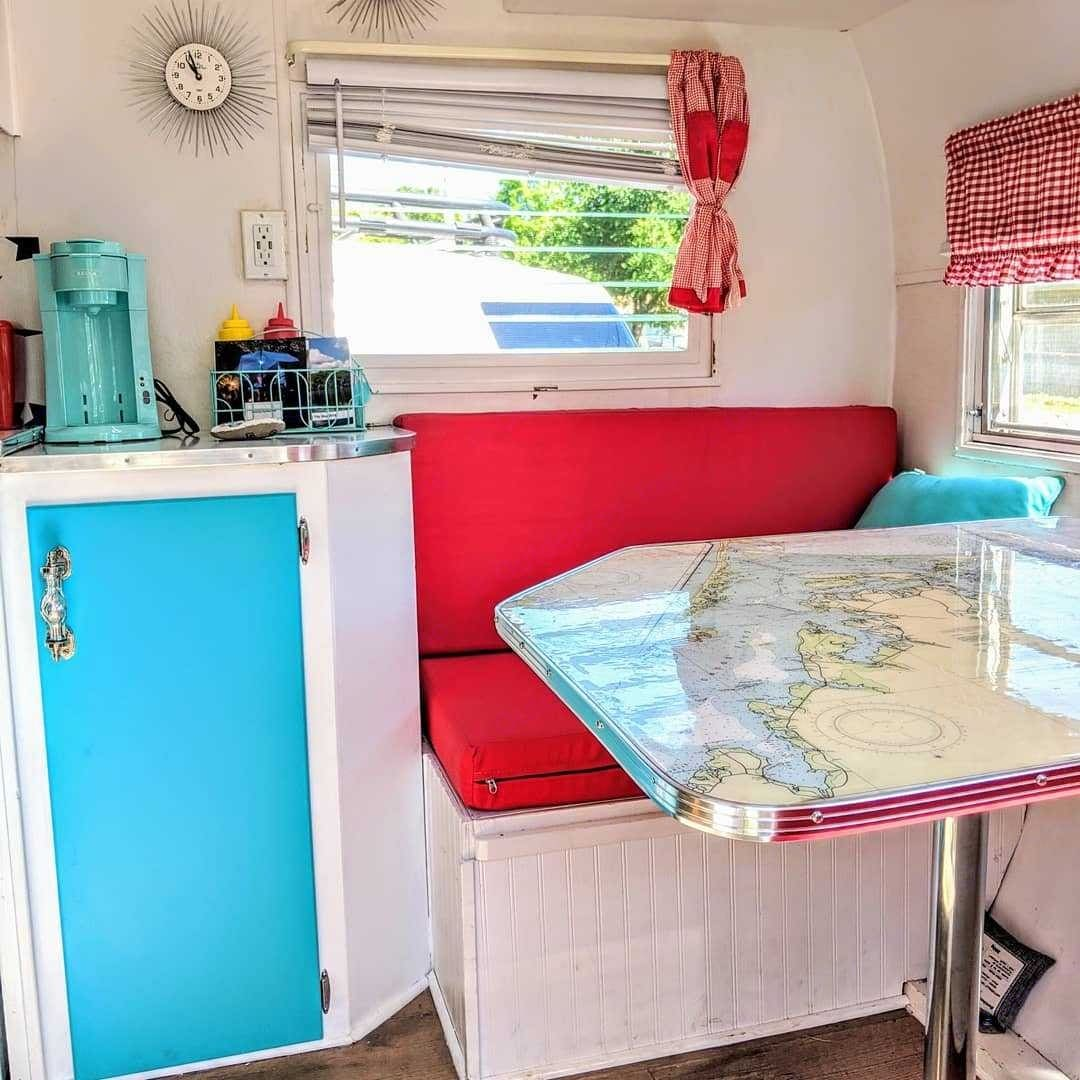 Dinette table has a custom top with map of the Outterbanks. Shasta Custom 1960