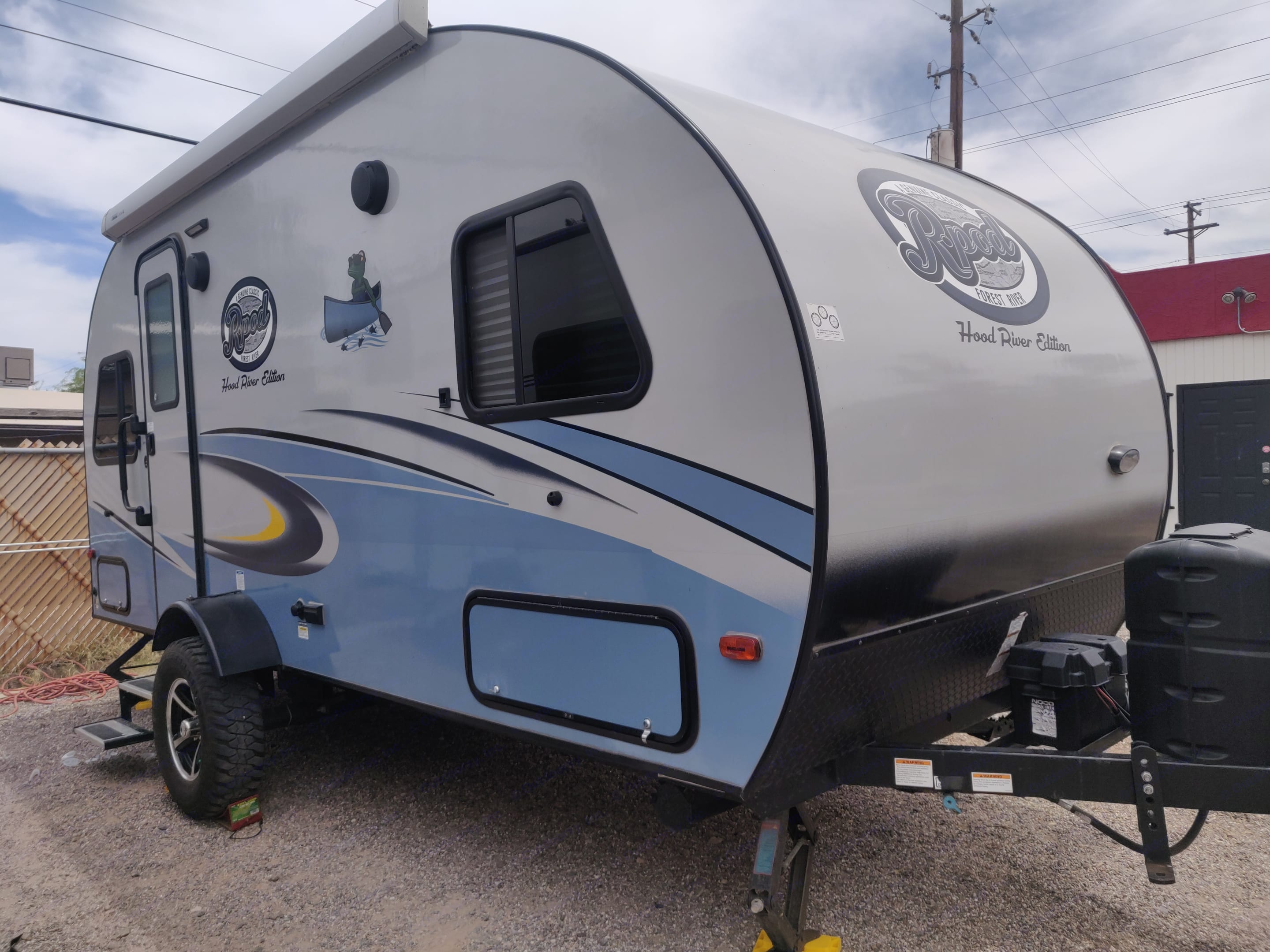 Entry side of the trailer- has outdoor speakers and an awning.. Forest River R-Pod 2019