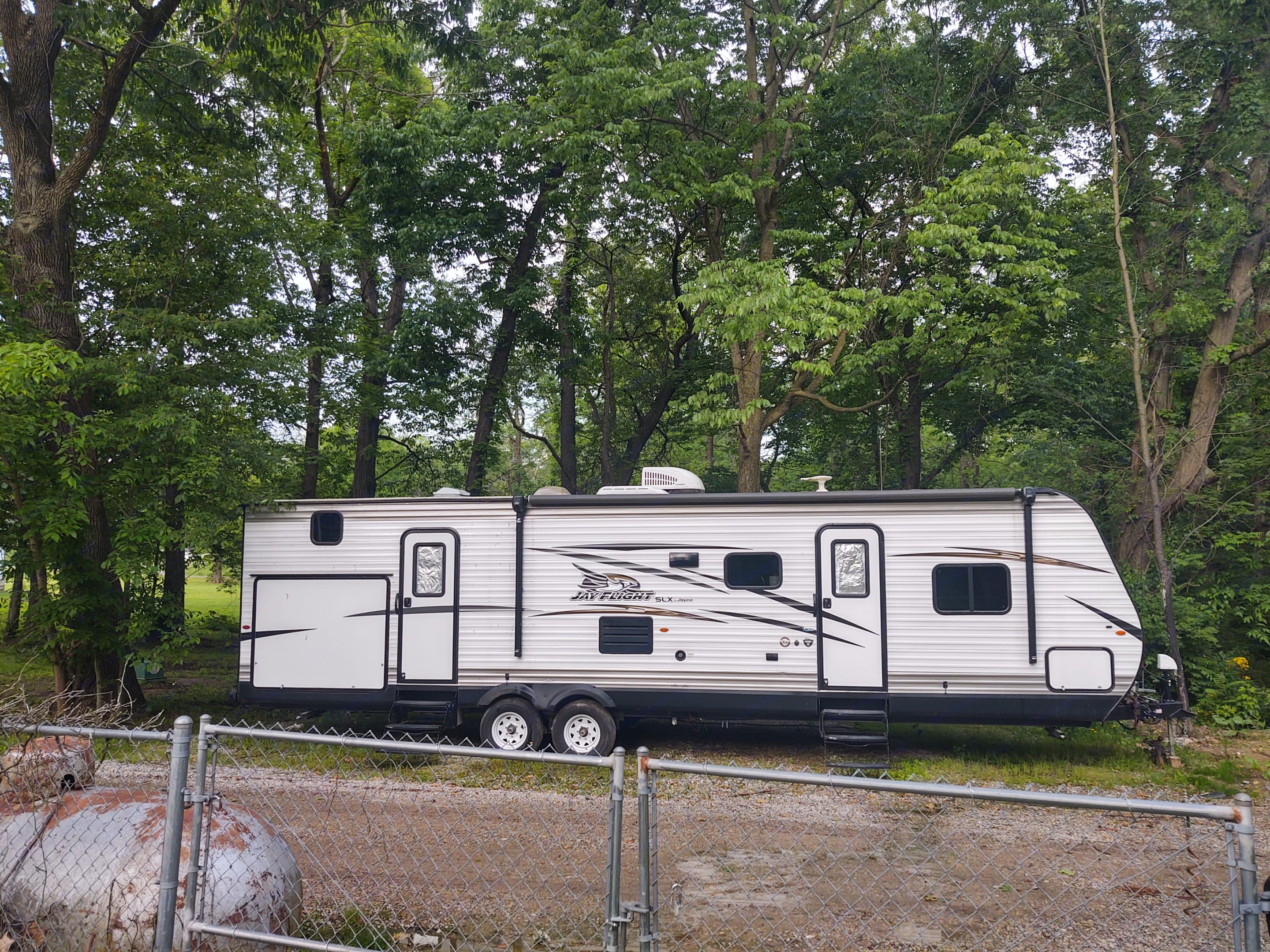 Outdoor kitchen has stove sink and refrigerator. Jayco Jay Flight 2018