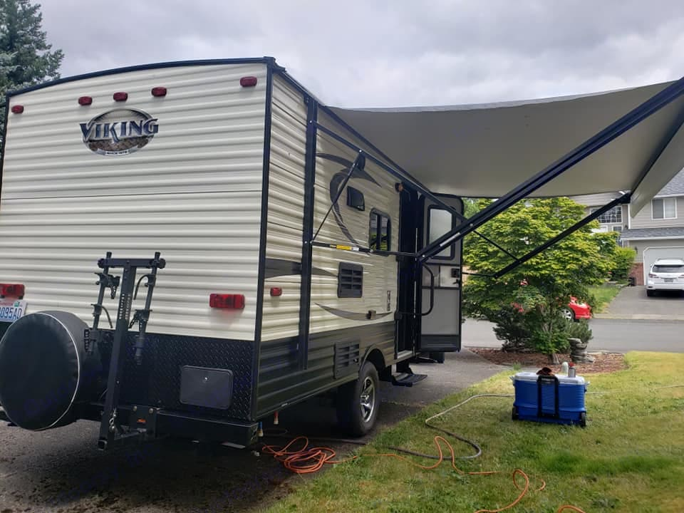 Electric Awning. Exterior Place Matt, Folding Table & Chairs, Cooler. (Included). Forest River Viking 2017