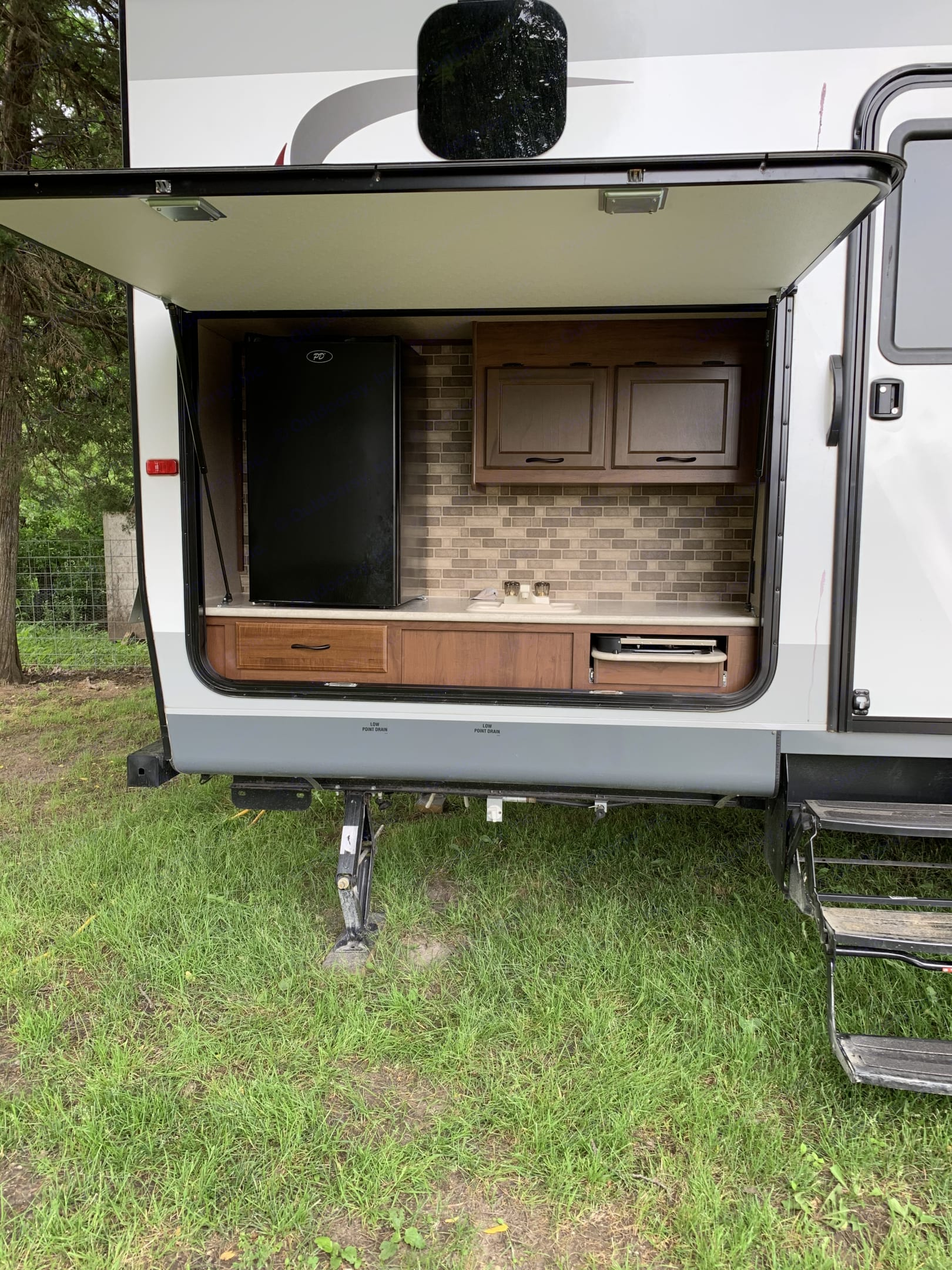 Outdoor kitchen, including fridge and propane grill space.. Jayco JayFlight 2015
