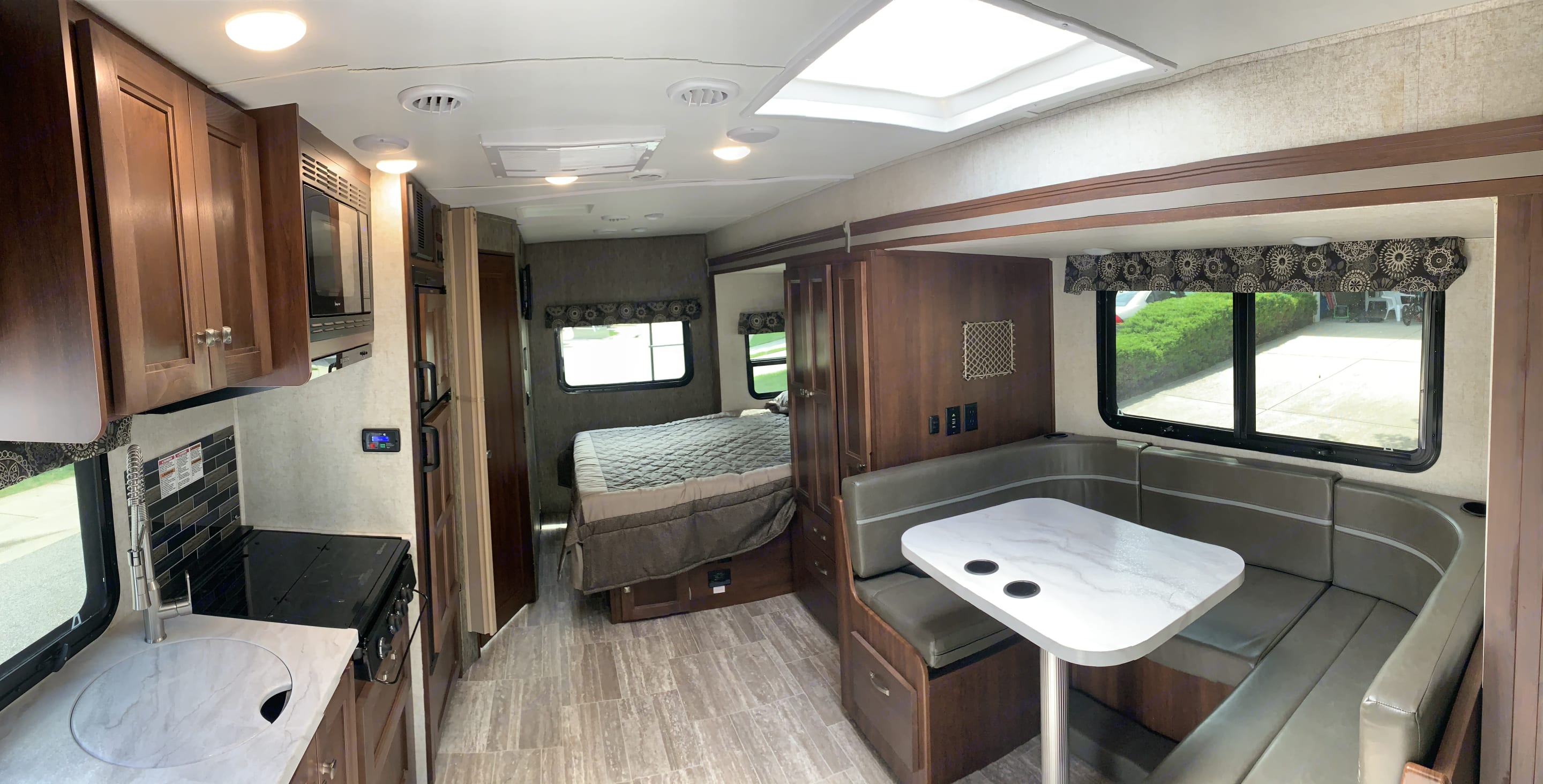 Full wall slide creates amazing space. Forest River Sunseeker 2019