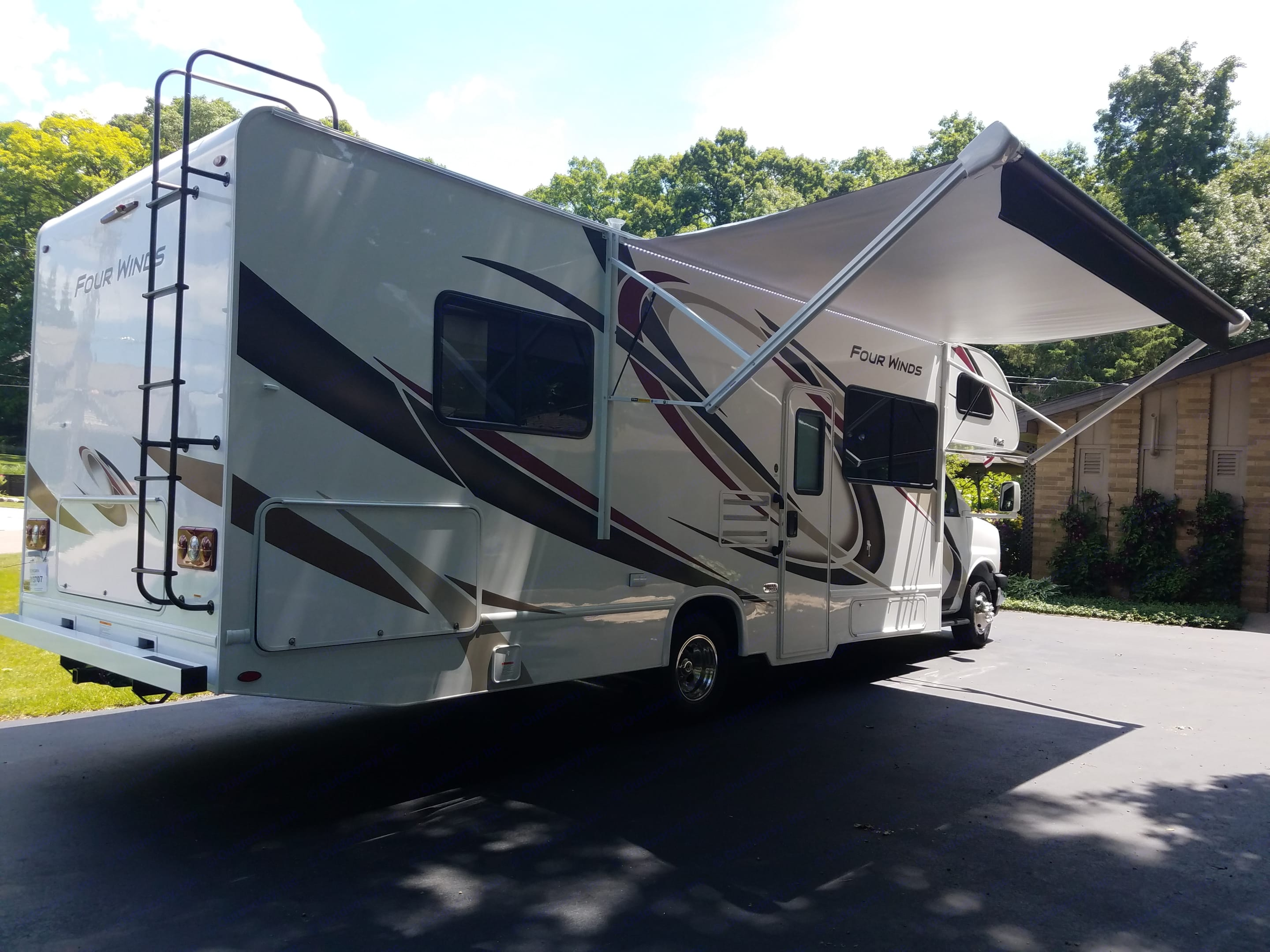 Awning with LED lights and large storage in back the full wide of coach. Thor Motor Coach Four Winds 2020