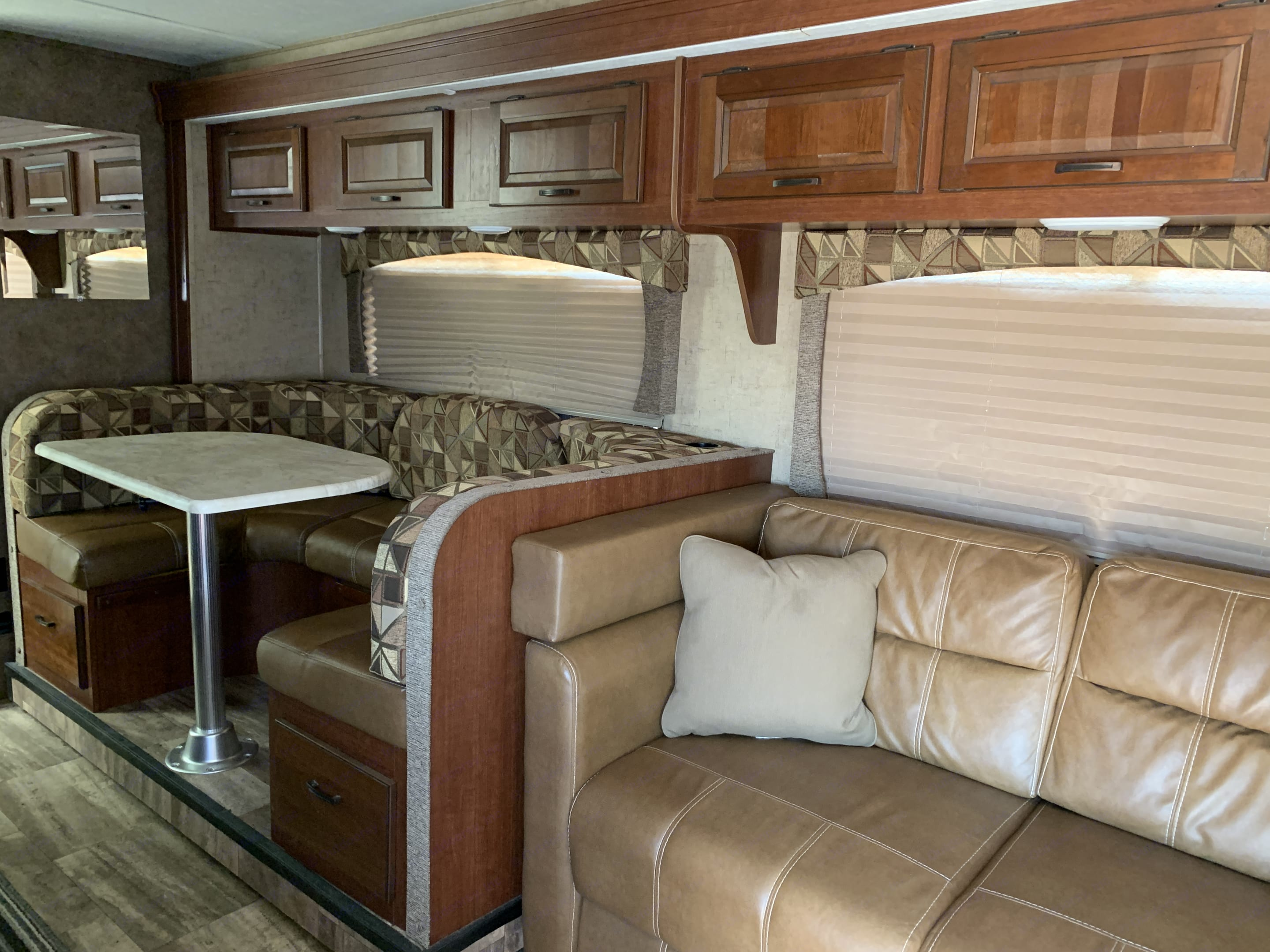 Dinette and sofa seating.. Forest River Sunseeker 2015