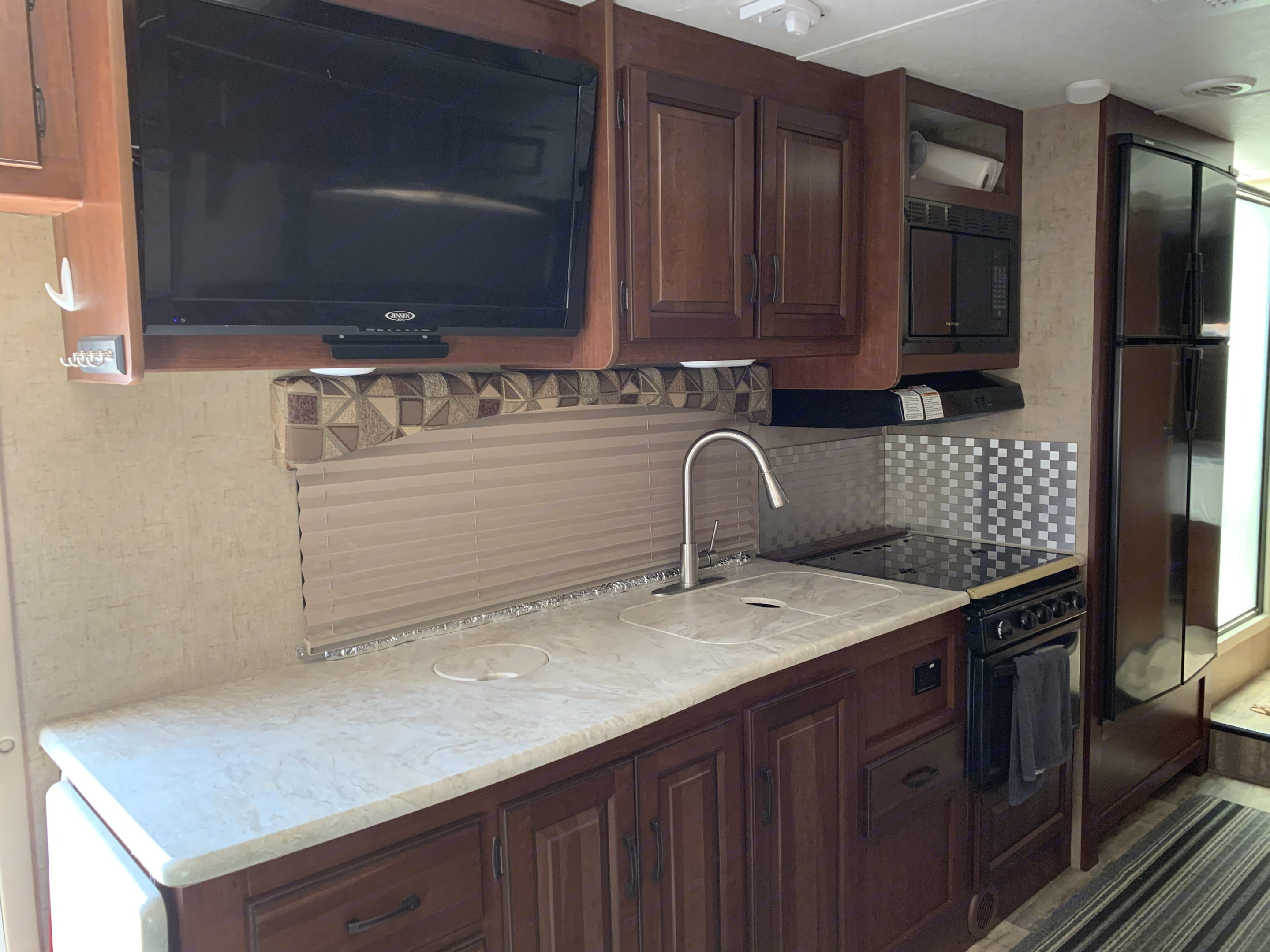 32 inch television with DVD player.. Forest River Sunseeker 2015