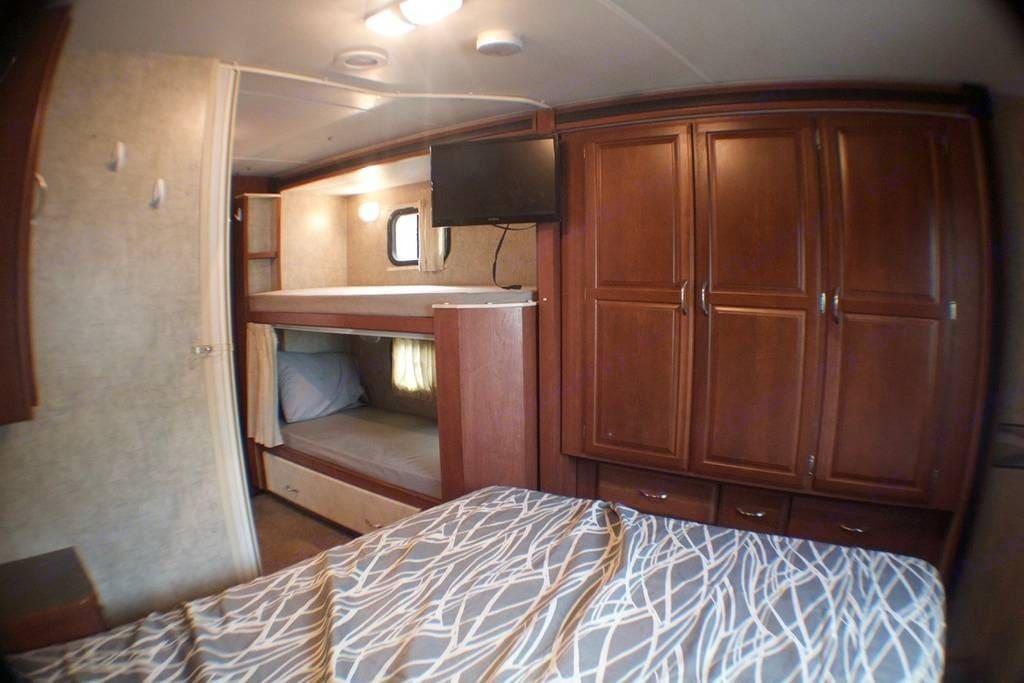 Bedroomwith a queen side bed. Winnebago Minnie Winnie 2015