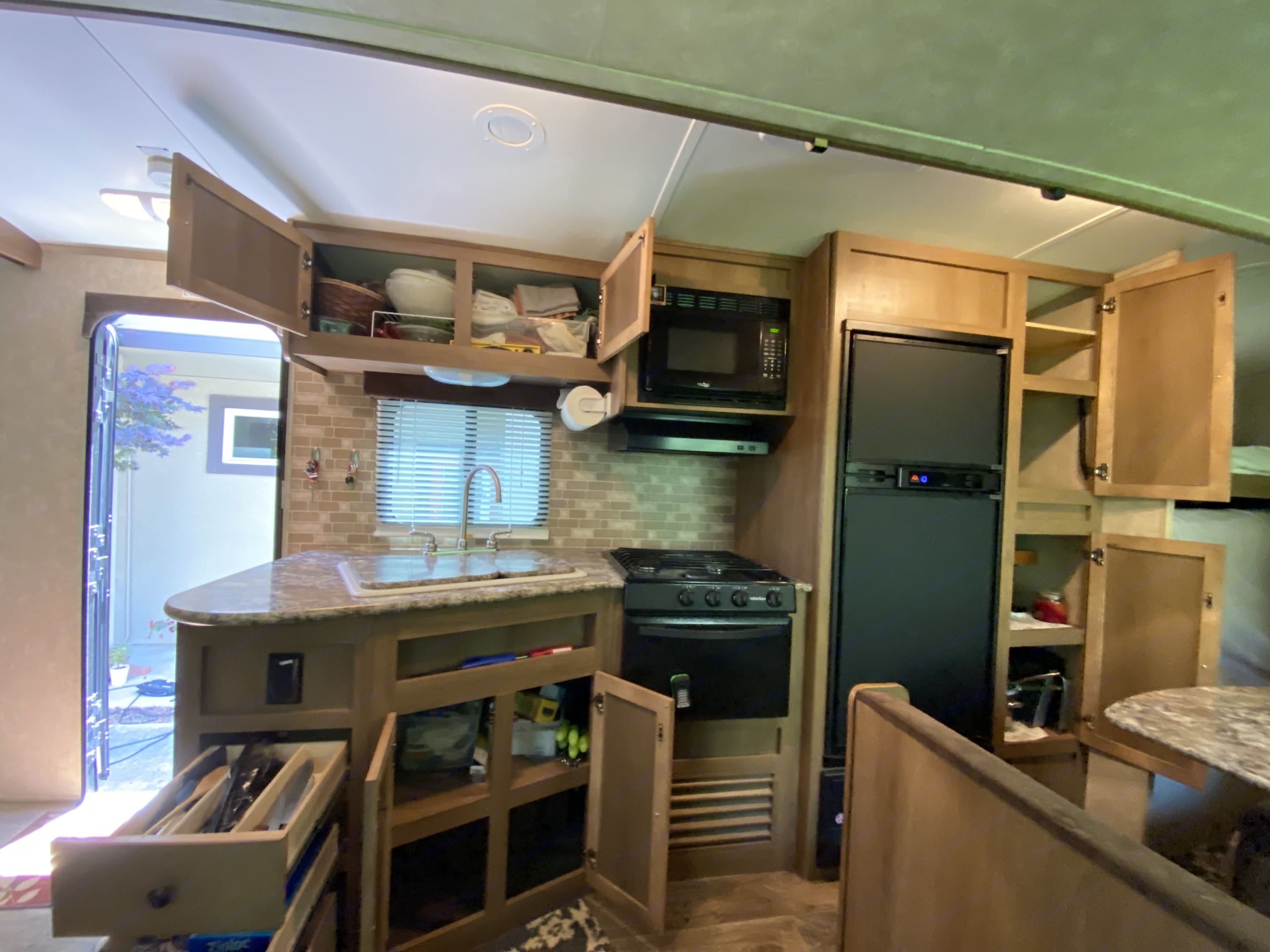 Lots of cabinet space in the kitchen. CruiserRvCorp ShadowCruiser 2014