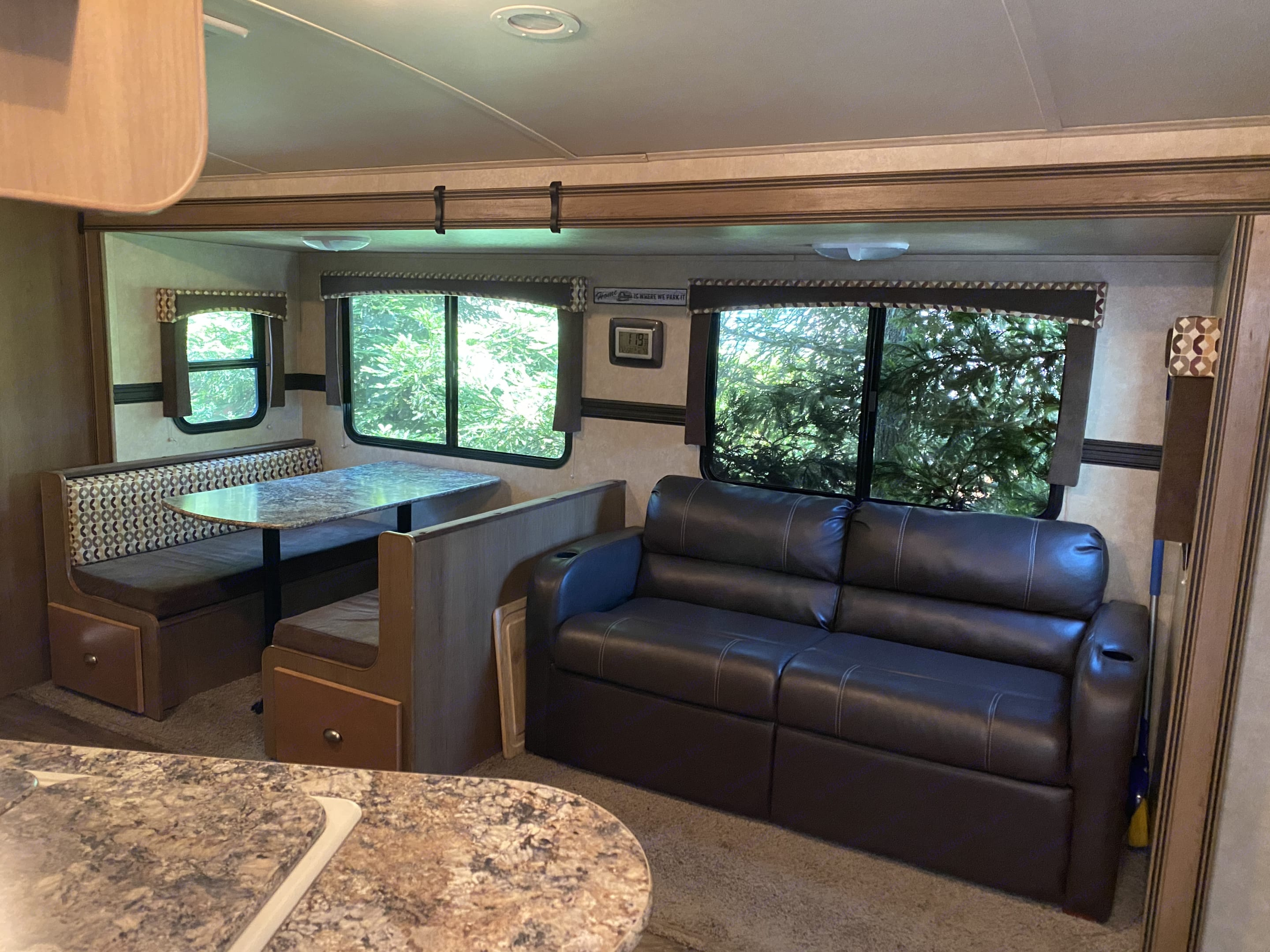 Both dinette and couch slide out for a large living space. CruiserRvCorp ShadowCruiser 2014