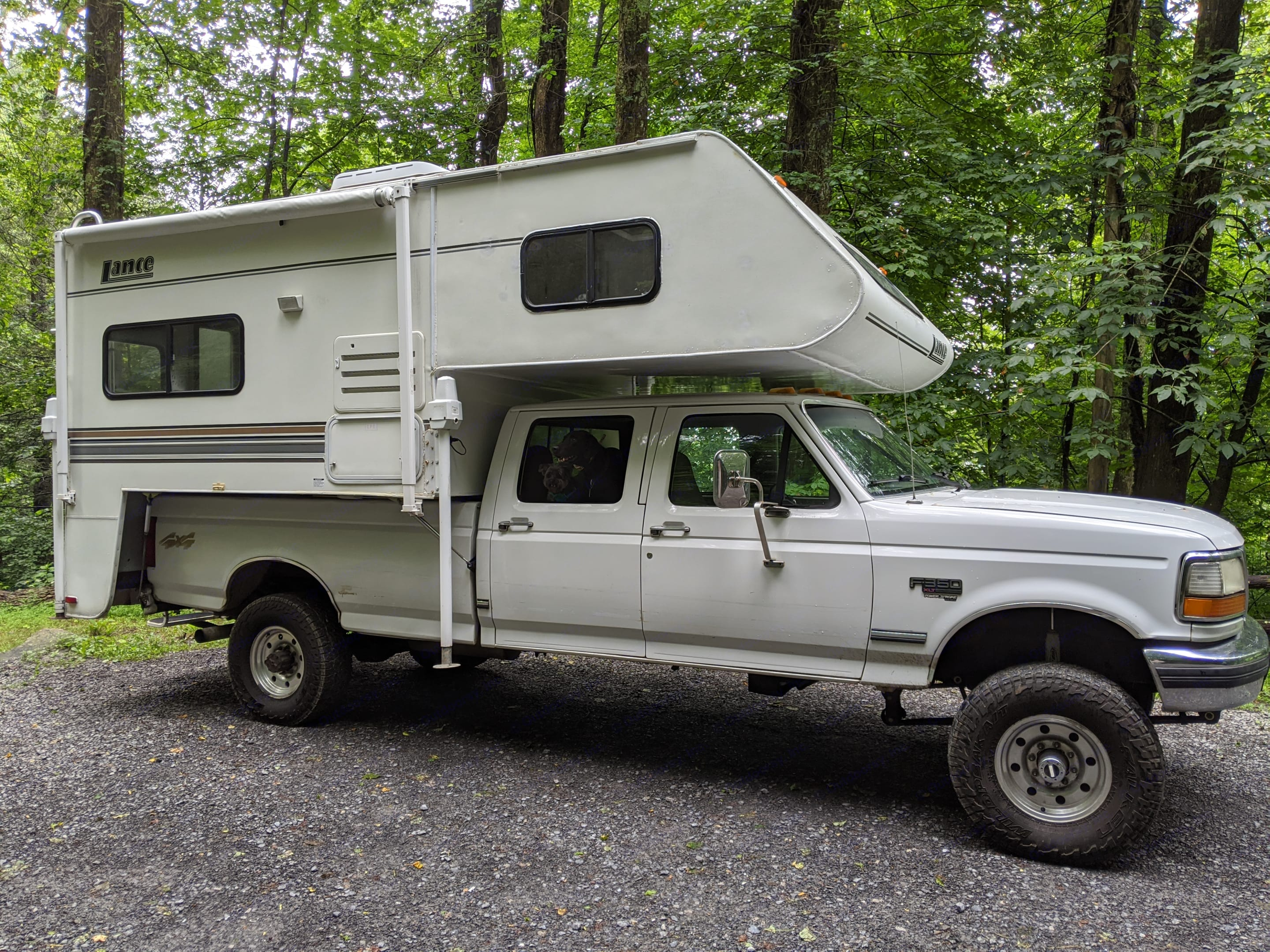 This truck-bed camper set-up (Lance and F-350 diesel truck) makes camping cozy and full of adventure!. Lance 915 2006