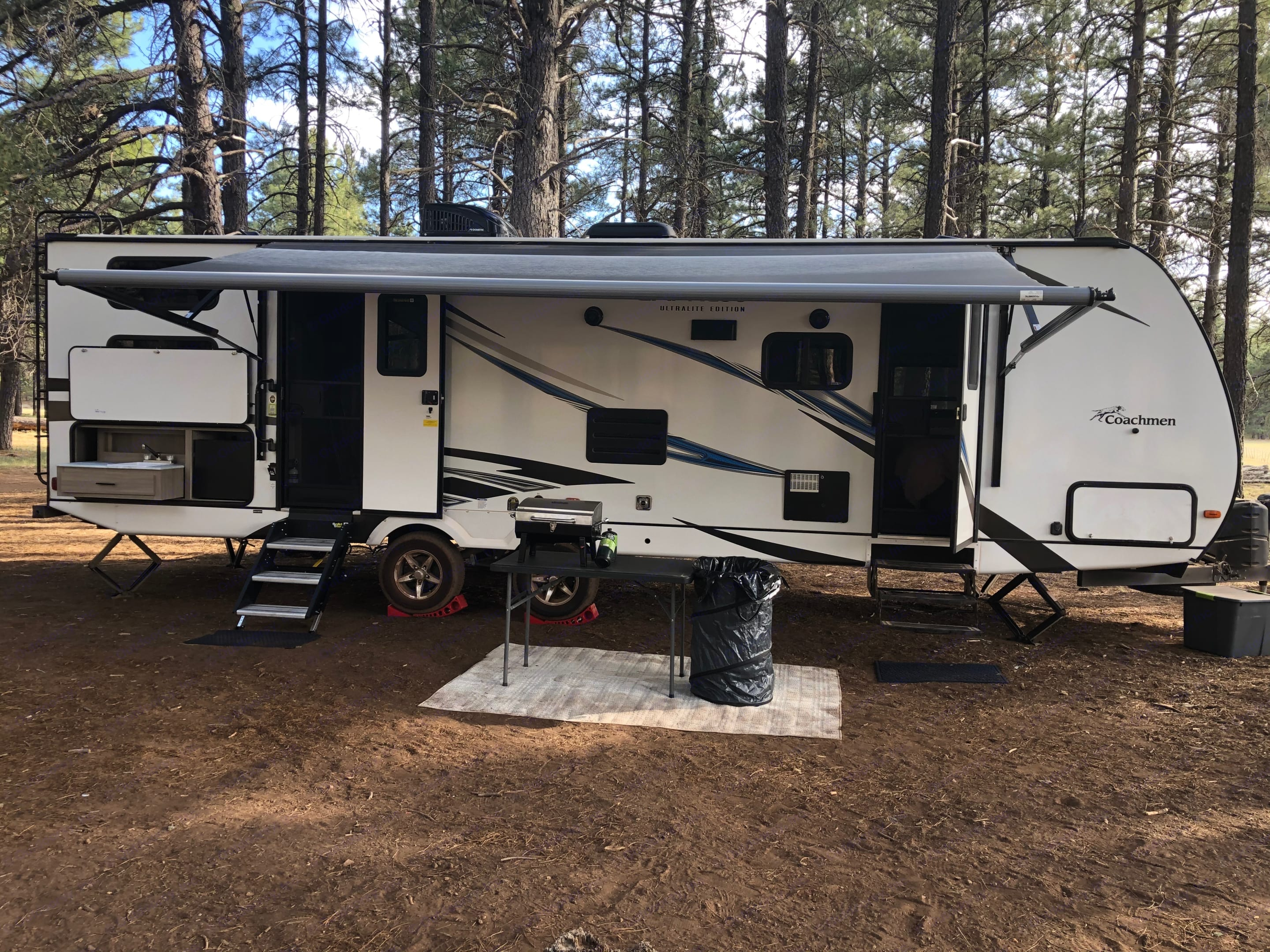 Side with awning out. Coachmen Freedom Express 2021