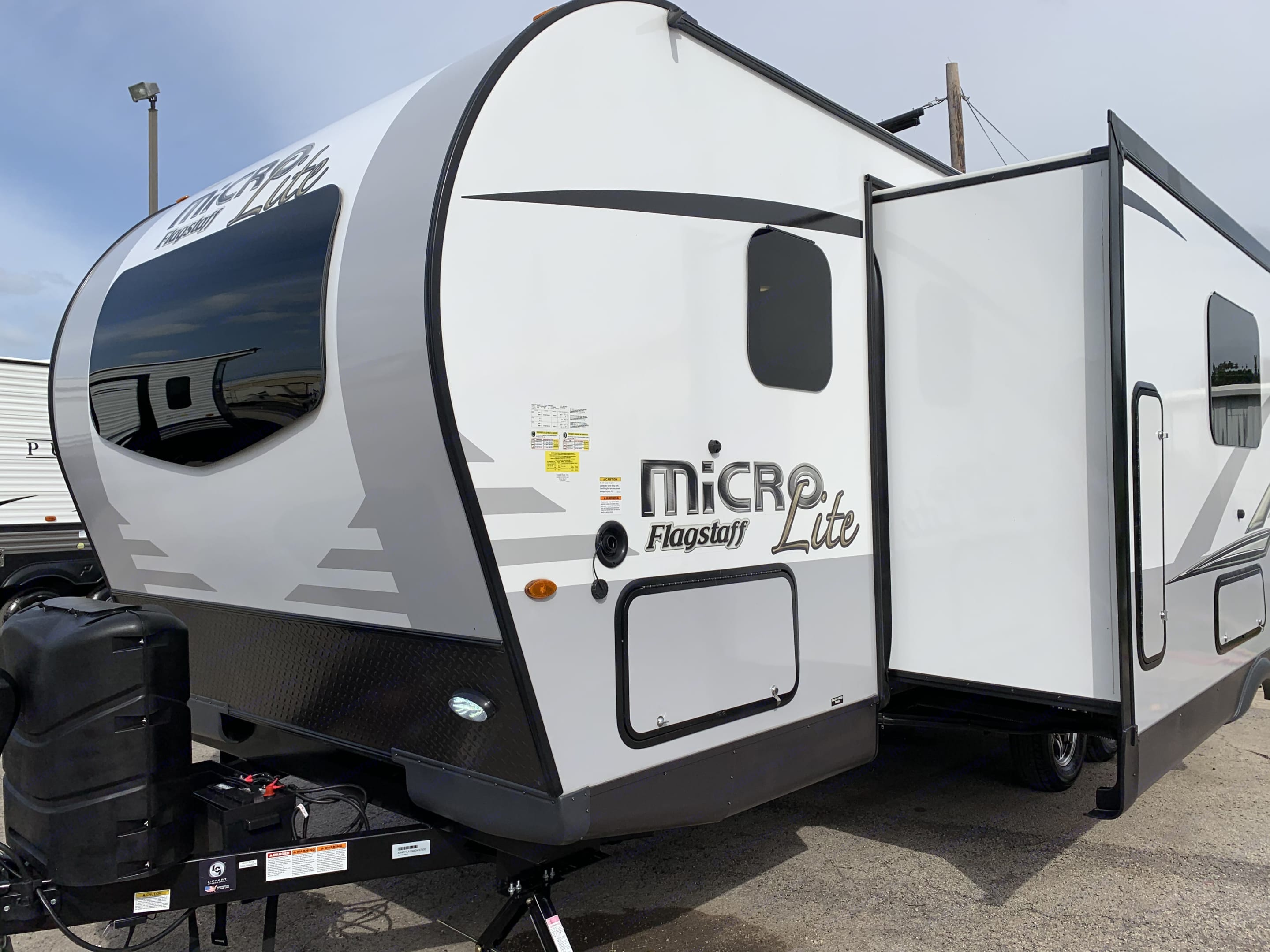 Roomy Trailer for a family, couples, or friends. It holds a party of 8 and includes all of the necessities needed for a great camping experience.. Forest River Flagstaff Micro Lite 2021