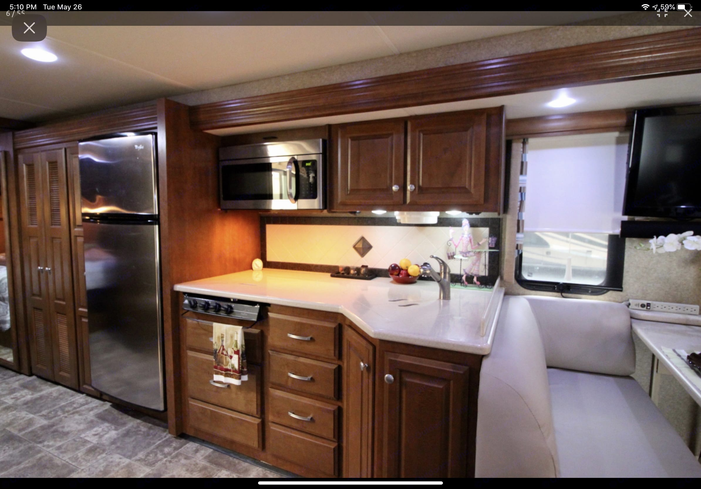 Kitchen with sink and stove insert covers. Thor Motor Coach Palazzo 2014