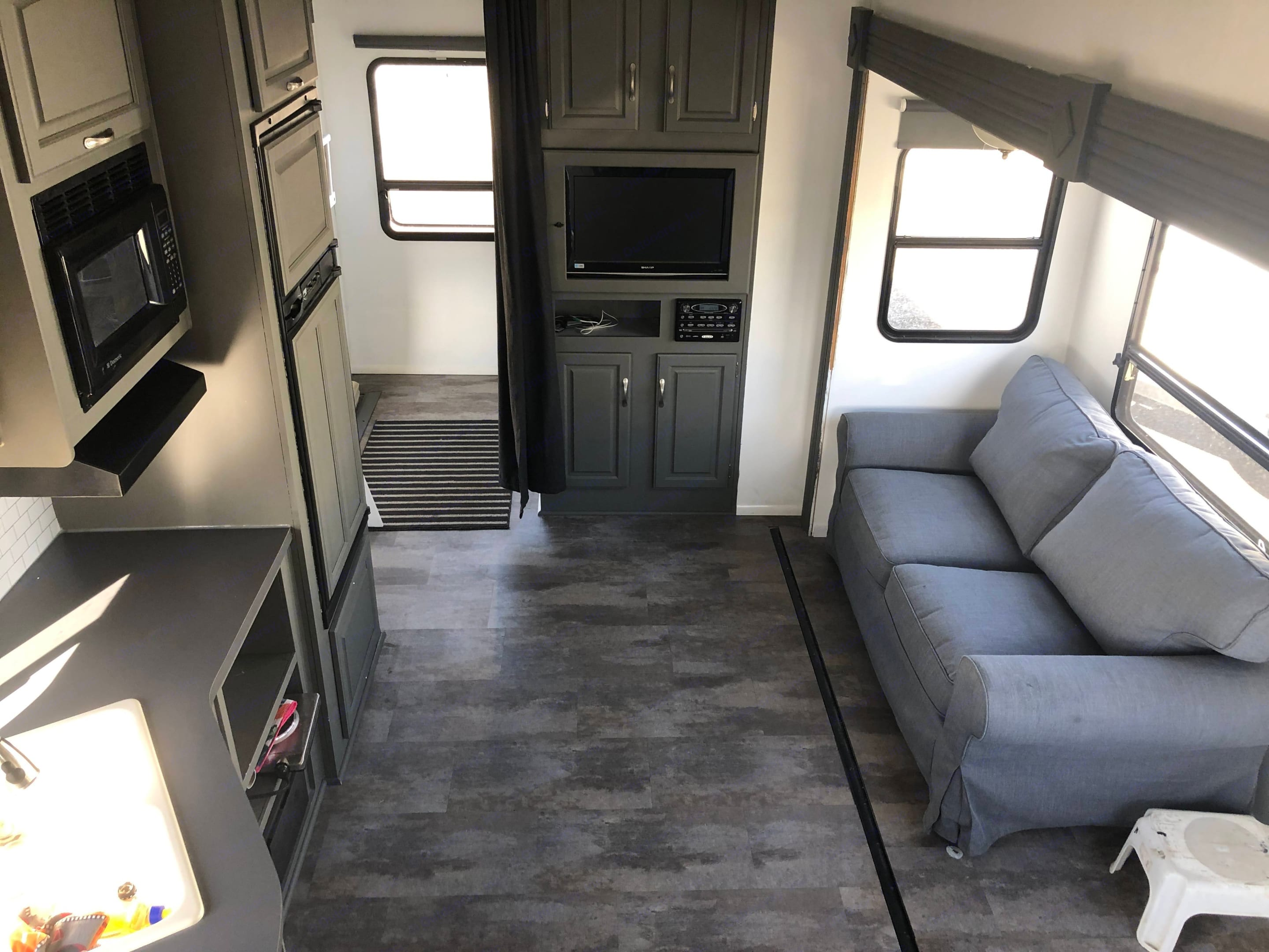 Couch is standard, does not fold out.  Plenty of room to add an air mattress if you so choose.. Jayco Eagle Super Lite 2009