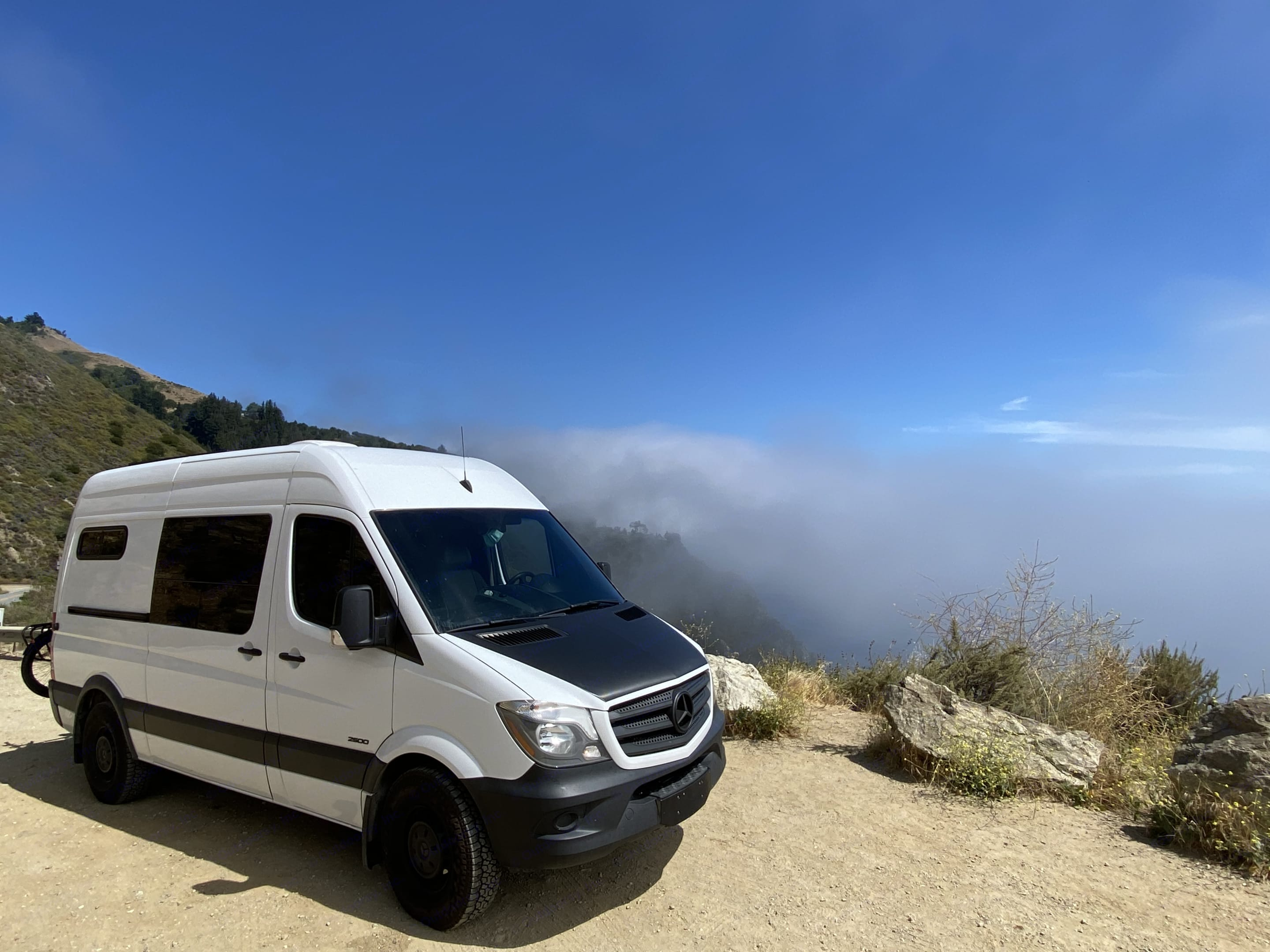 Watching the fog roll in over the cliffs in Big Sur. Mercedes Sprinter 2015