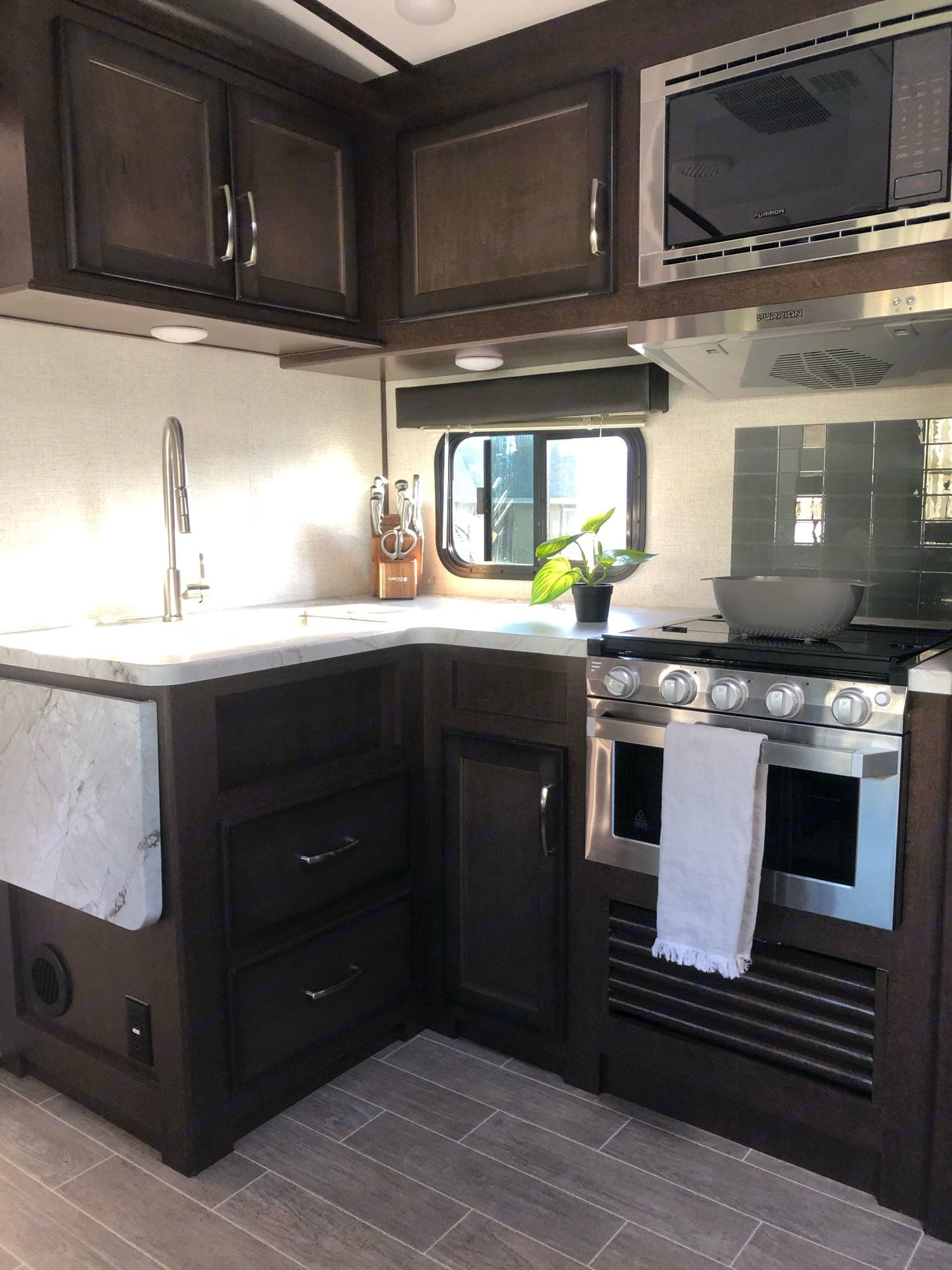 The kitchen complete with an oven, stove and microwave.. Dutchmen Other 2020