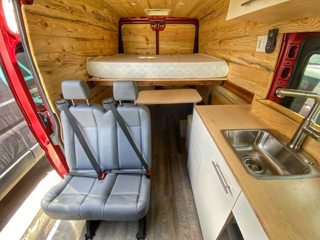 Looking toward the back with the dinette table swiveled out. Dodge Ram Promaster 2500 2020