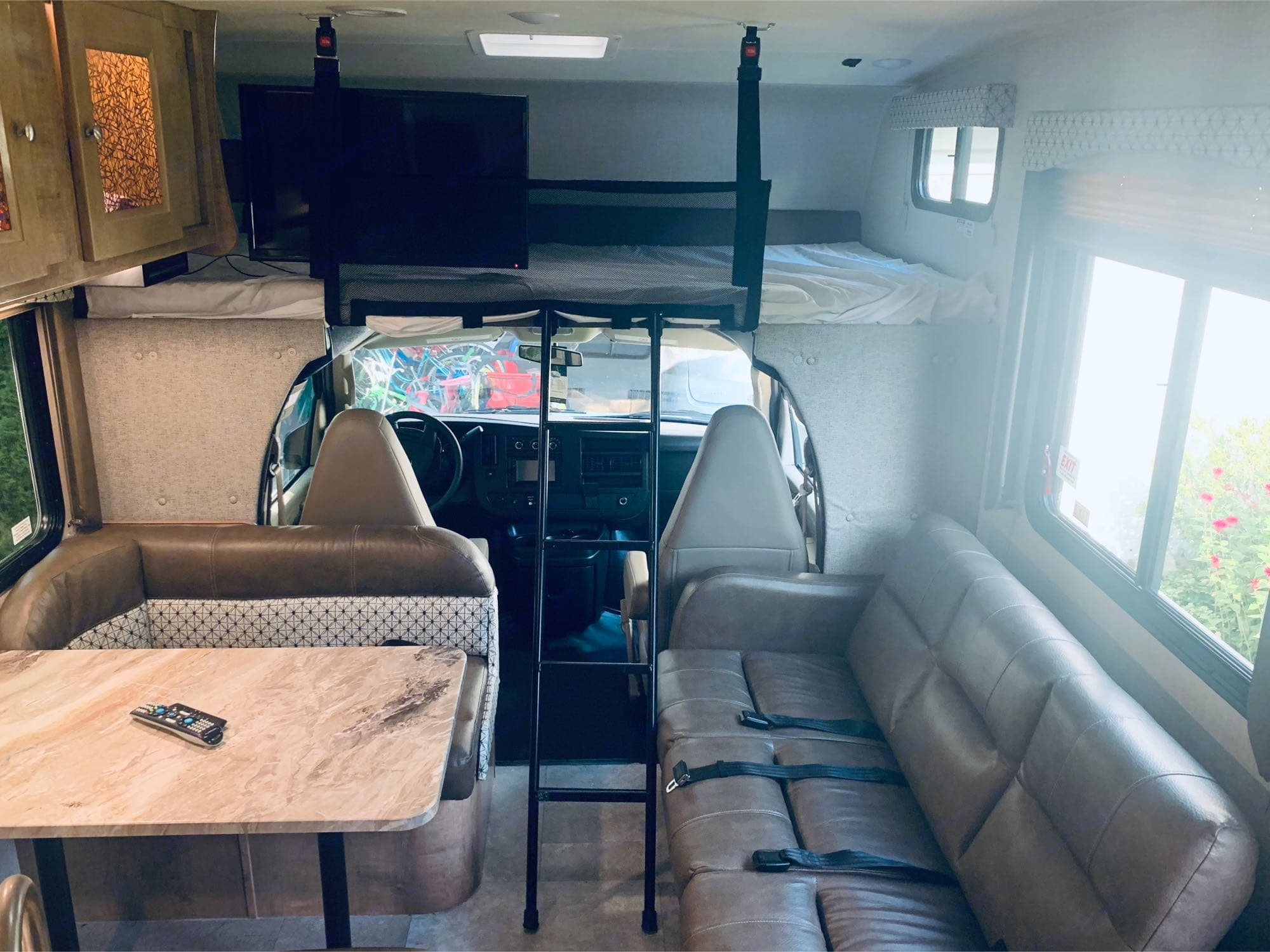 The dining table converts to a bed and the couch converts to another bed.. Coachmen Leprechaun 2020