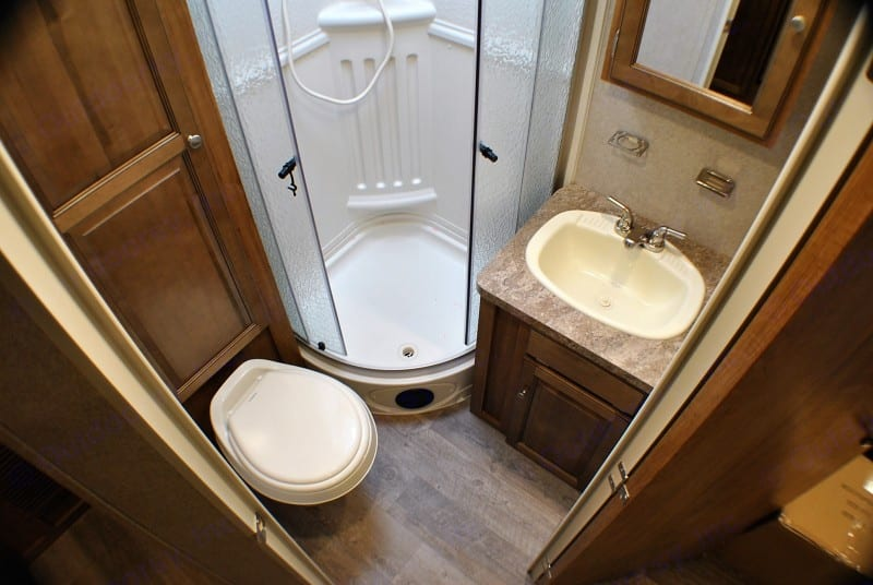 Full bathroom, standup corner shower. Forest River Rockwood Roo 2018