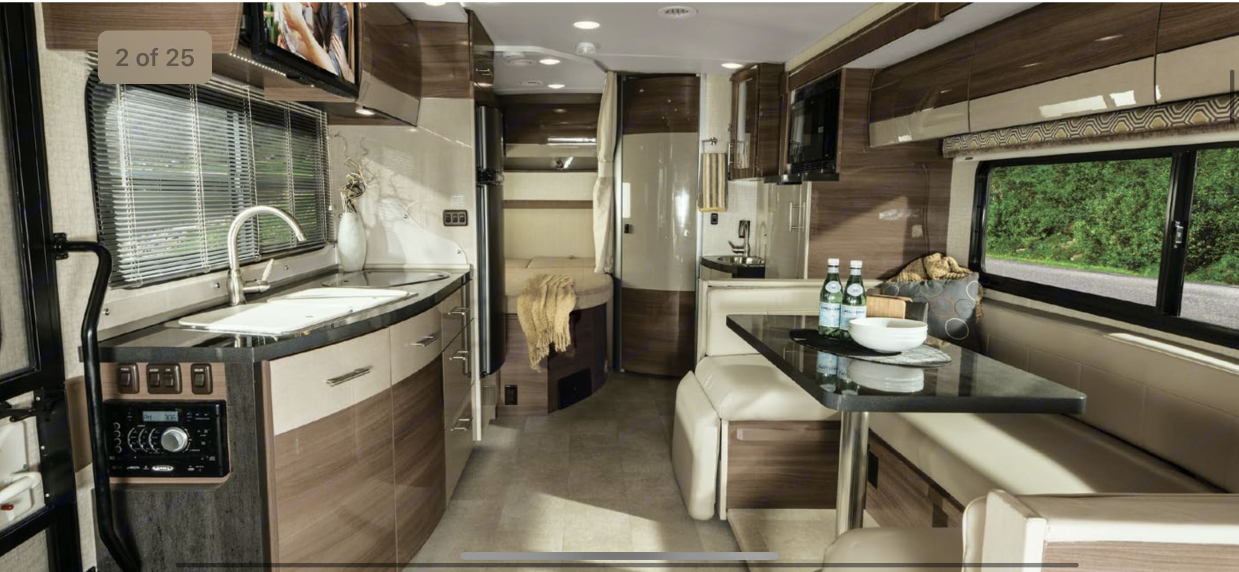 Dinette has 3 Seat belts and seats 5 for meals. Winnebago Navion 2015