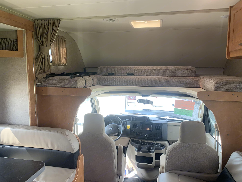 Queen size bed above driver's seat. Winnebago Minnie Winnie 2019