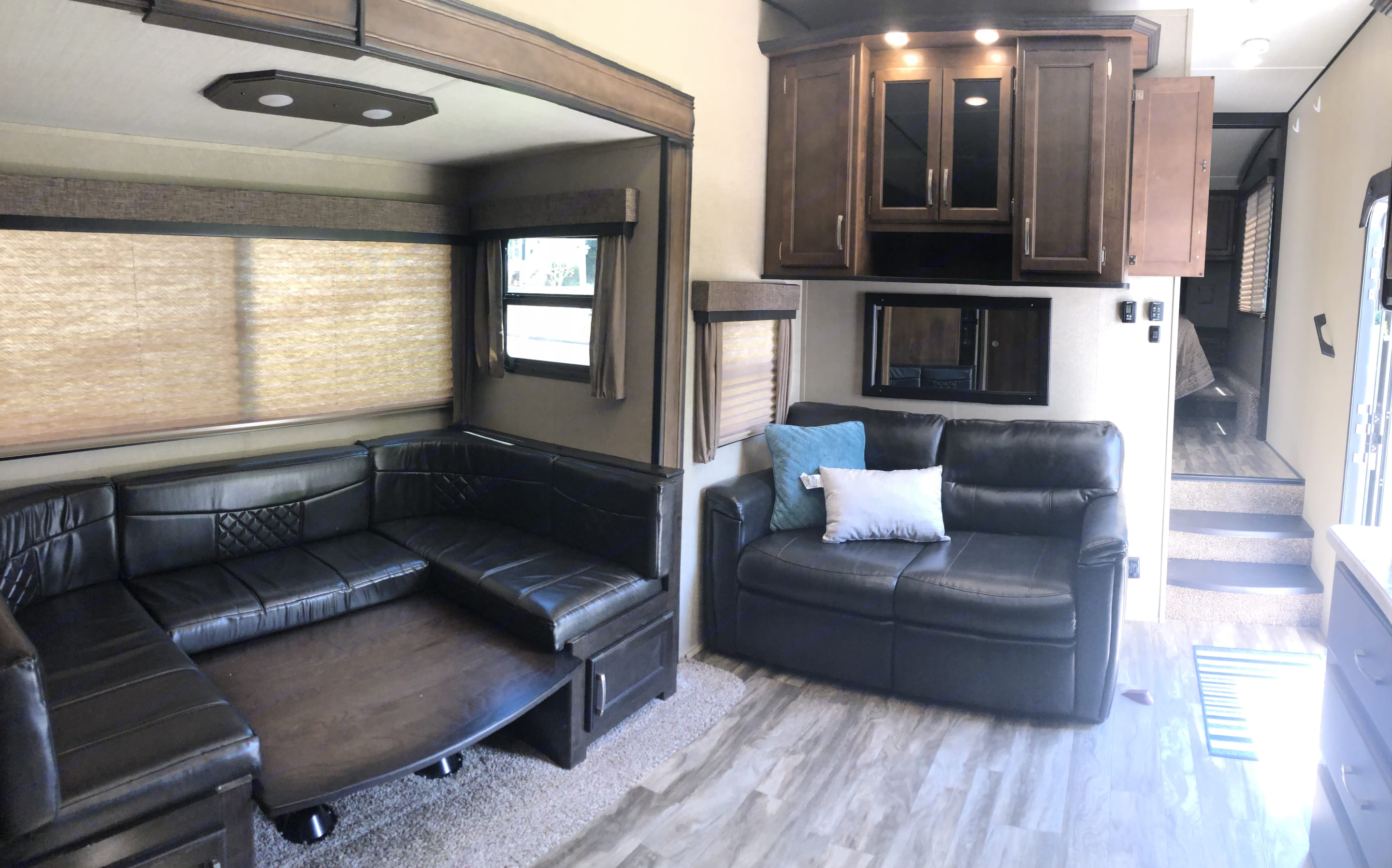 Dinette and sofa fold down into additional beds. Grand Design Reflection 2018