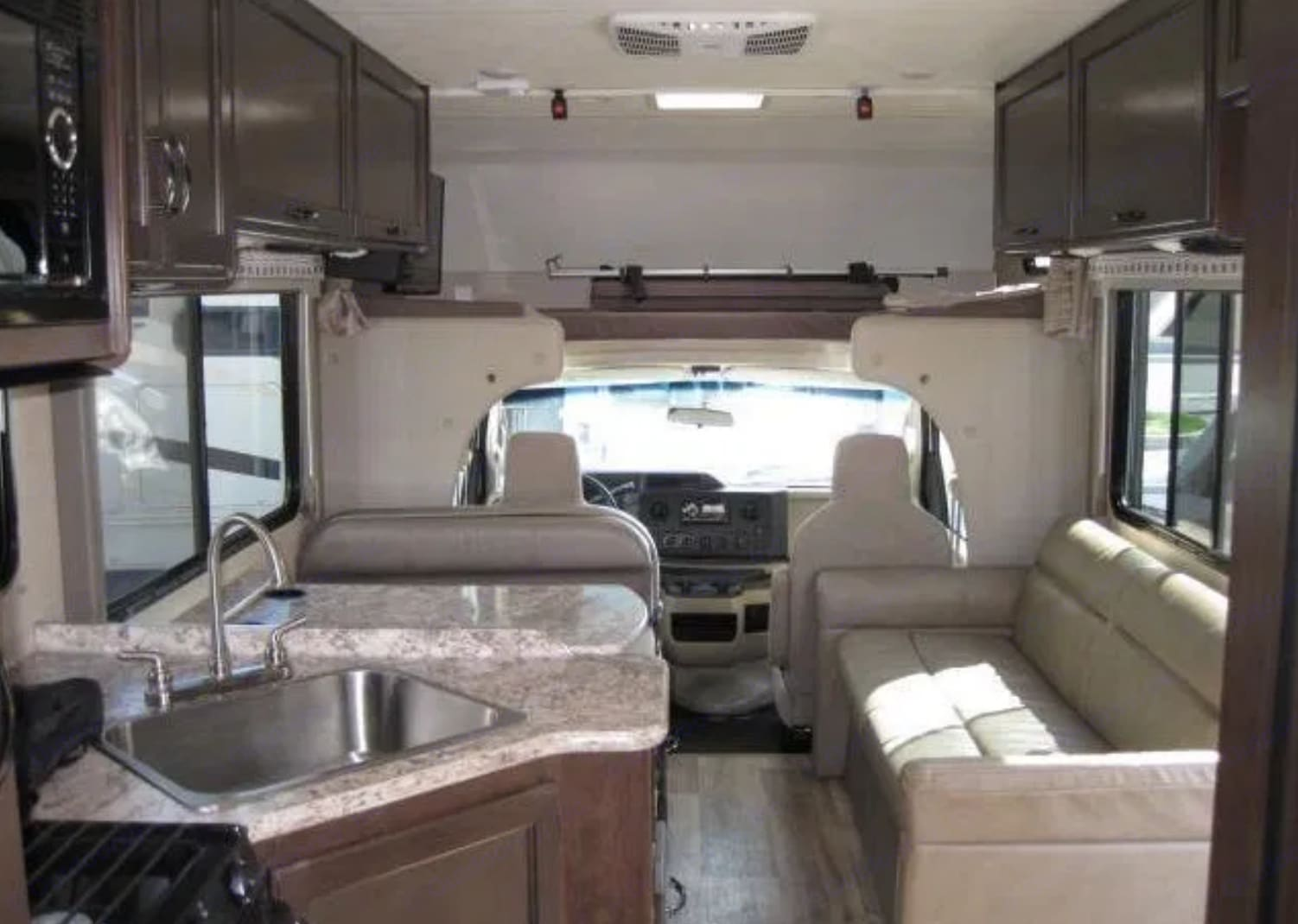 The interior is spacious and modern with lots of user friendly features. Lauren appreciates the large (by RV standards) sink.. Thor Four Winds 26b 2019