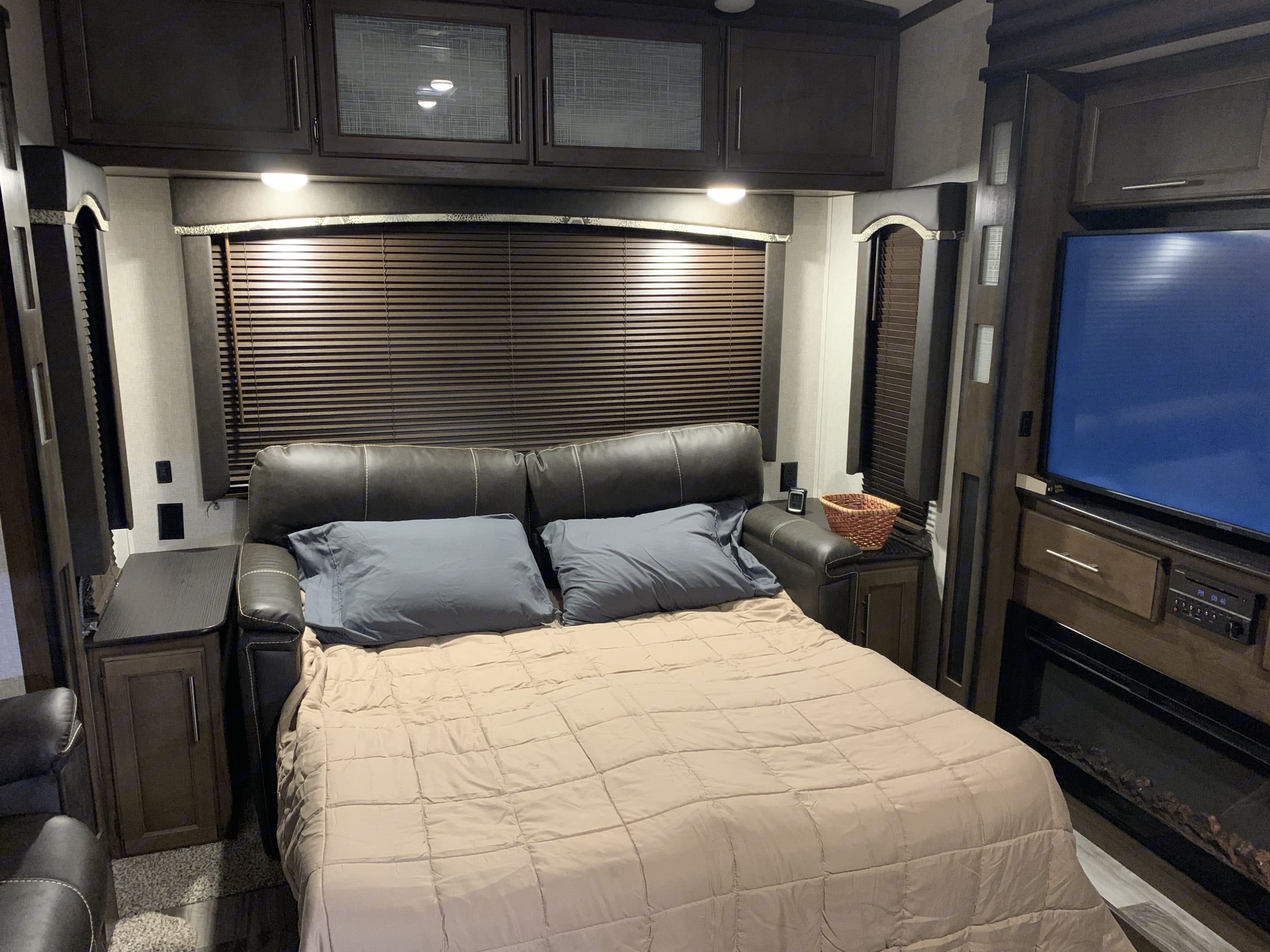 Living Area sofa converted to Full Size Bed. Keystone Cougar 2018