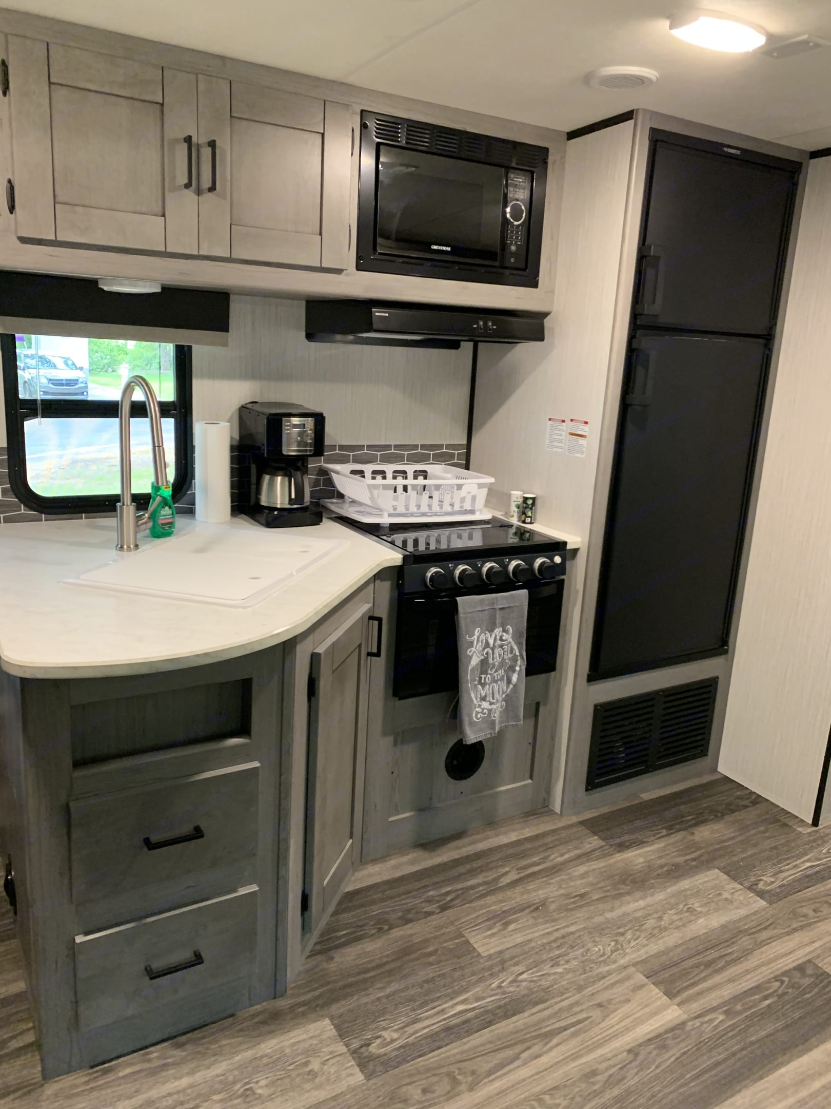 Kitchen has deep sink bowl, pull-out faucet and a long list of included amenities.. Heartland MallardM32 2021