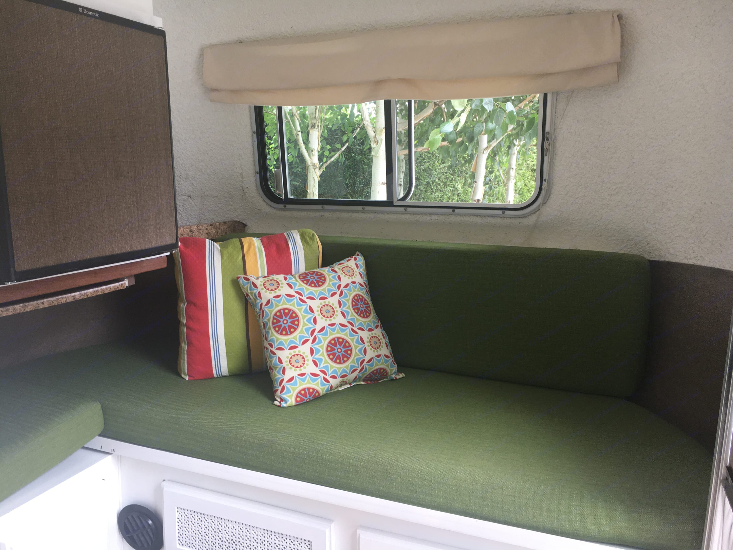 The couch/reading nook also expands into a second bed. Vintage Trailers Other 1980