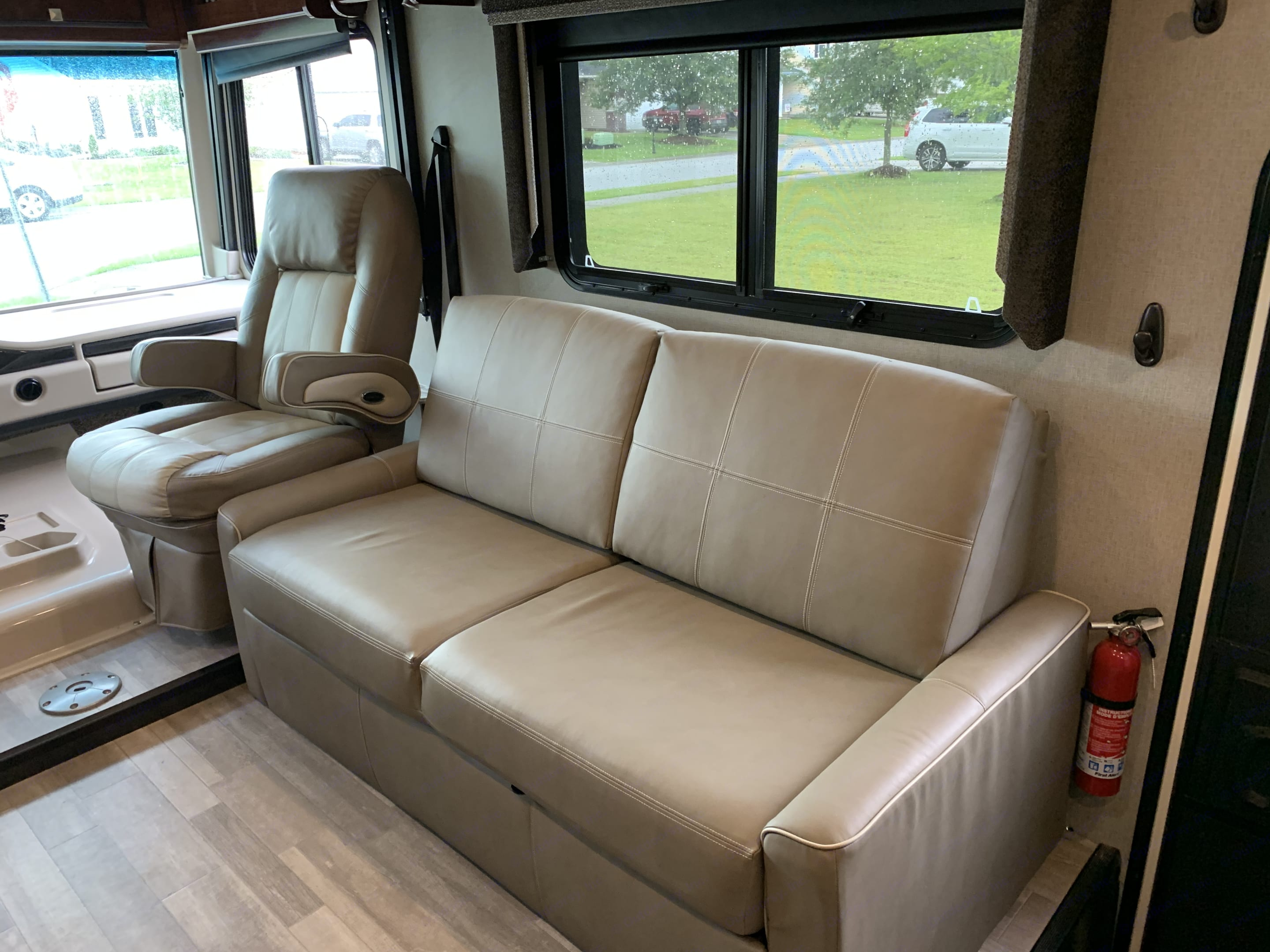 Love seat sofa and captains chair for lounging or watching TV.. Holiday Rambler Admiral 2019