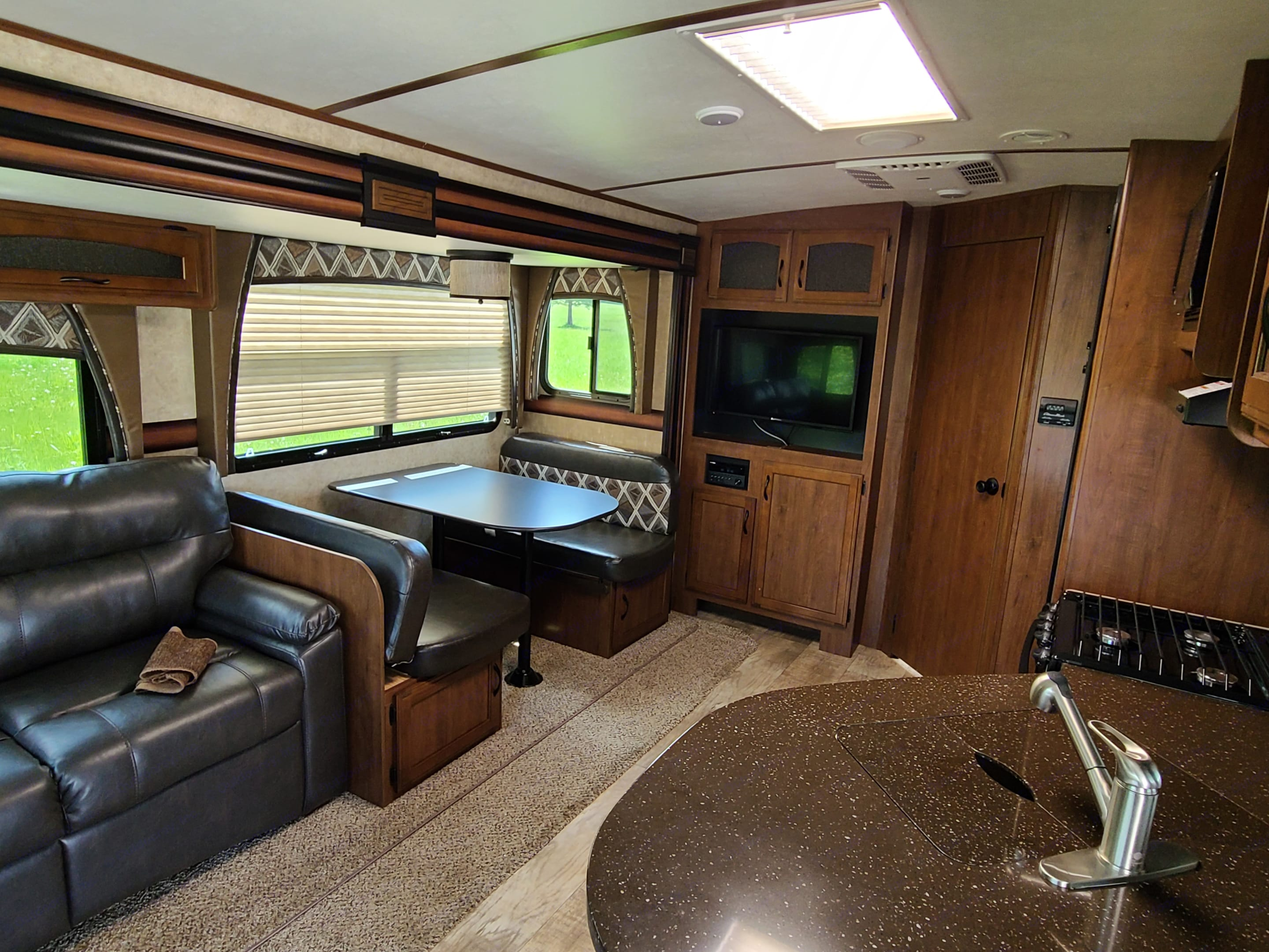 Spacious and very comfortable living. So much comfort for roughing it! LOL. Jayco White Hawk 2016