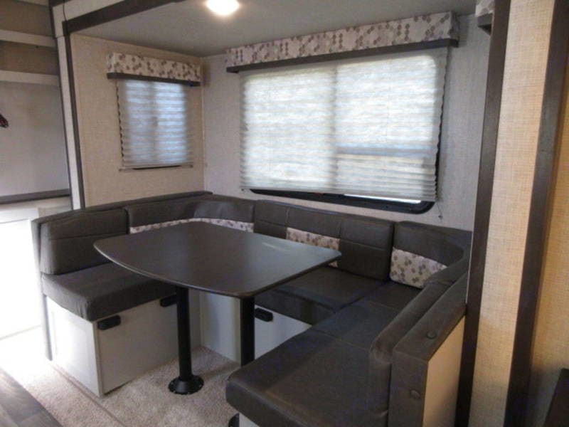 U- shaped dinette converts to a double bed. Keystone Bullet 2020