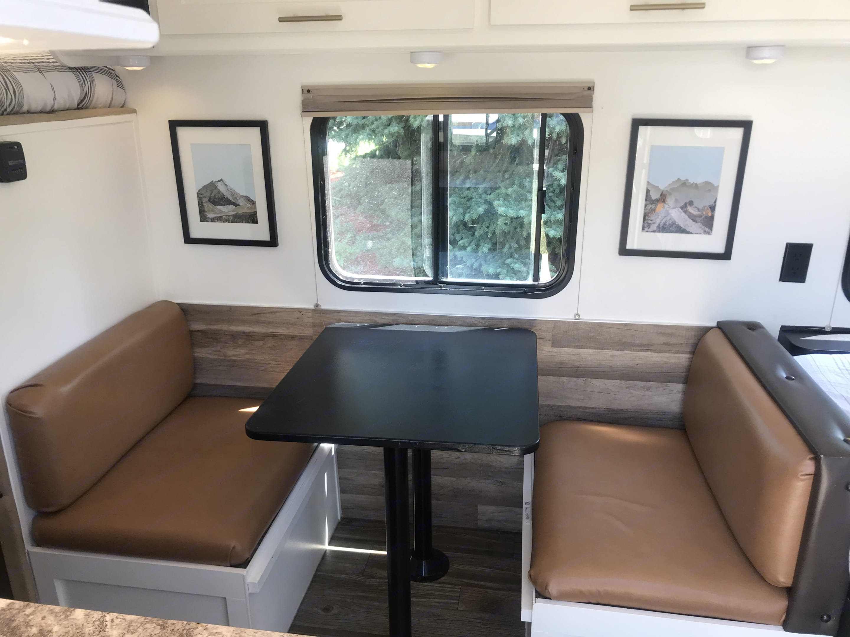 This dinette converts to a bed and also provides storage underneath the cushions. They have been reupholstered with new faux leather! . Forest River Wolf Pup 2016