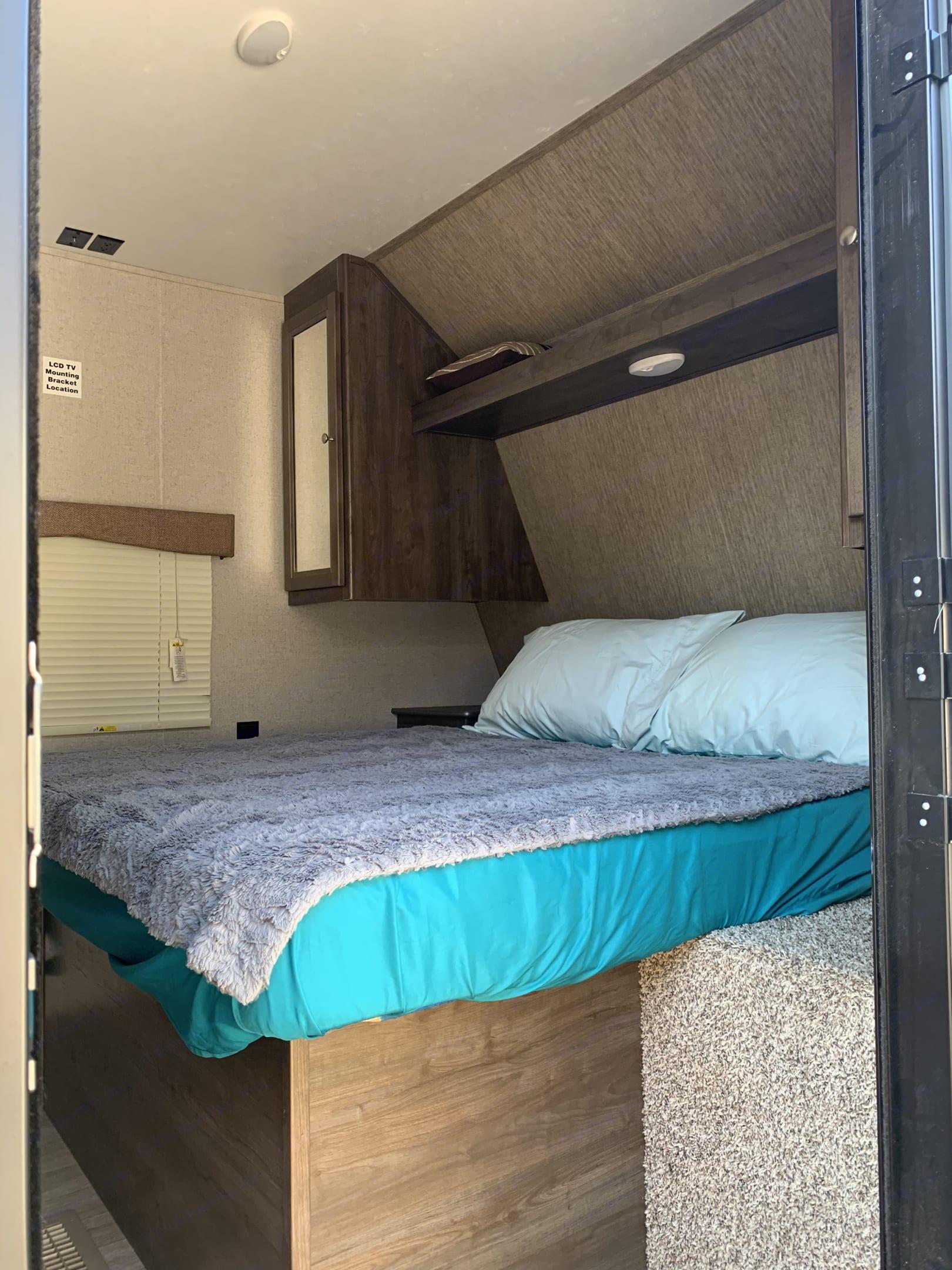 Master bedroom from separate entry door. Dutchmen Coleman 2018
