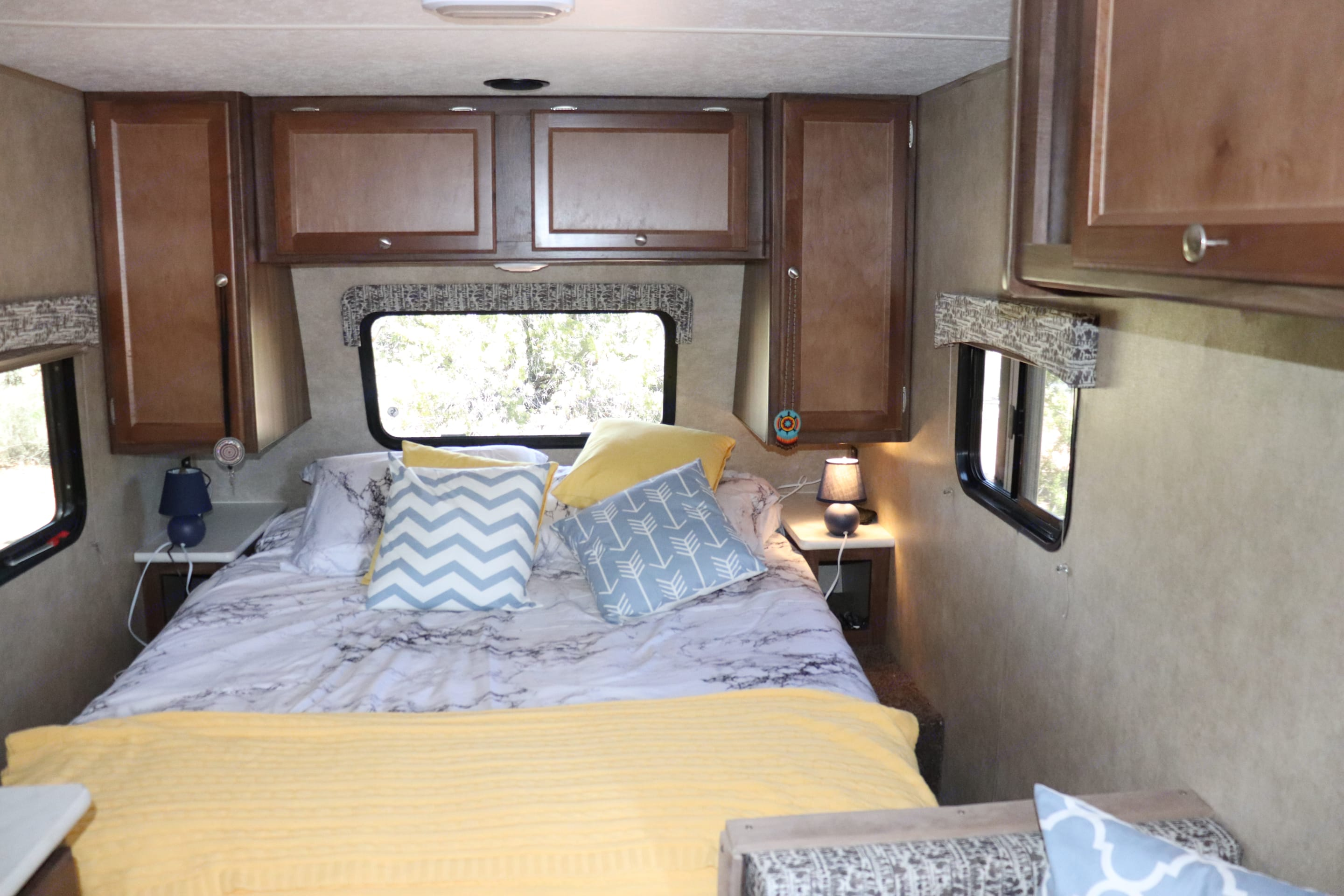 queen size comfortable bed access on both sides. Forest River Viking 2019