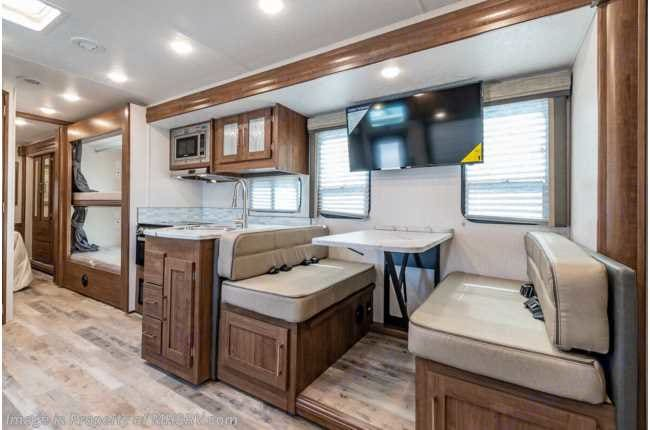 TV for viewing while in transit and that table drops down to make a nice bed for two children if necessary, to nap. Coachmen Pursuit 2021