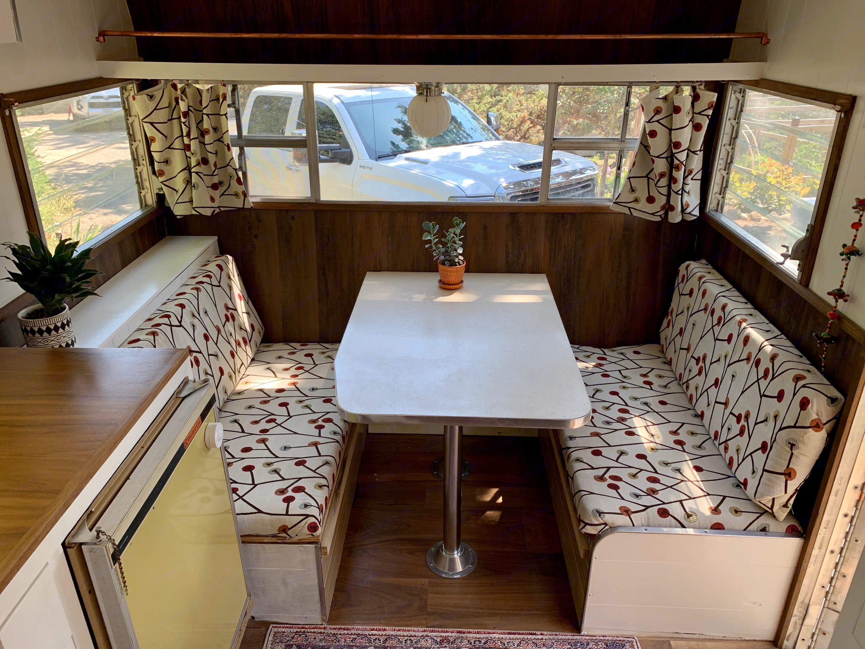 Dinette converts to short bed and seats 4.. Shasta 1500 1965