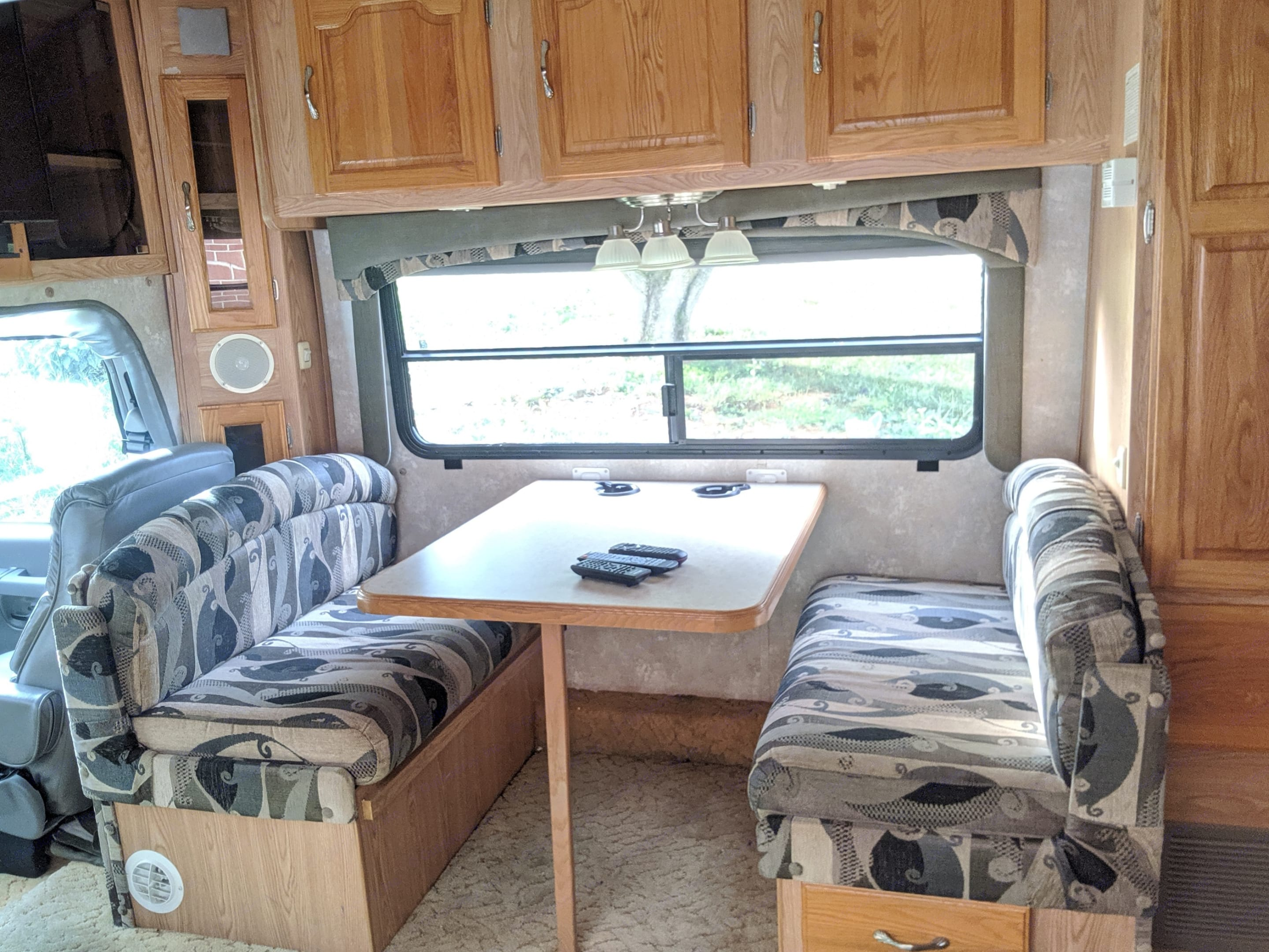 Table (converts to full-size bed). Coachmen Concord 2003