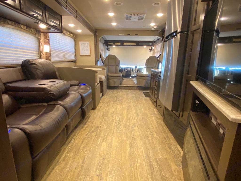 Living area with slides open. Thor Motor Coach Hurricane 2018