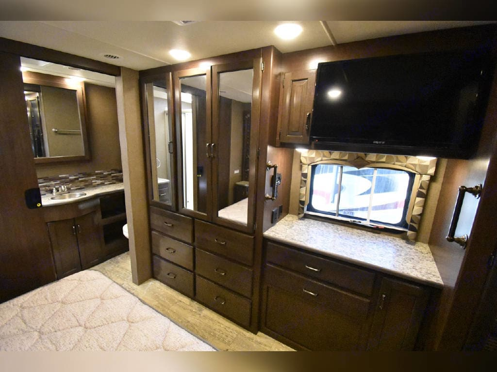 Master bedroom cabinet space and TV. Thor Motor Coach Hurricane 2018